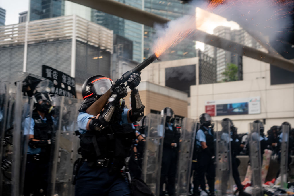 A police officer fires teargas during a protest on June 12, 2019 in Hong Kong.