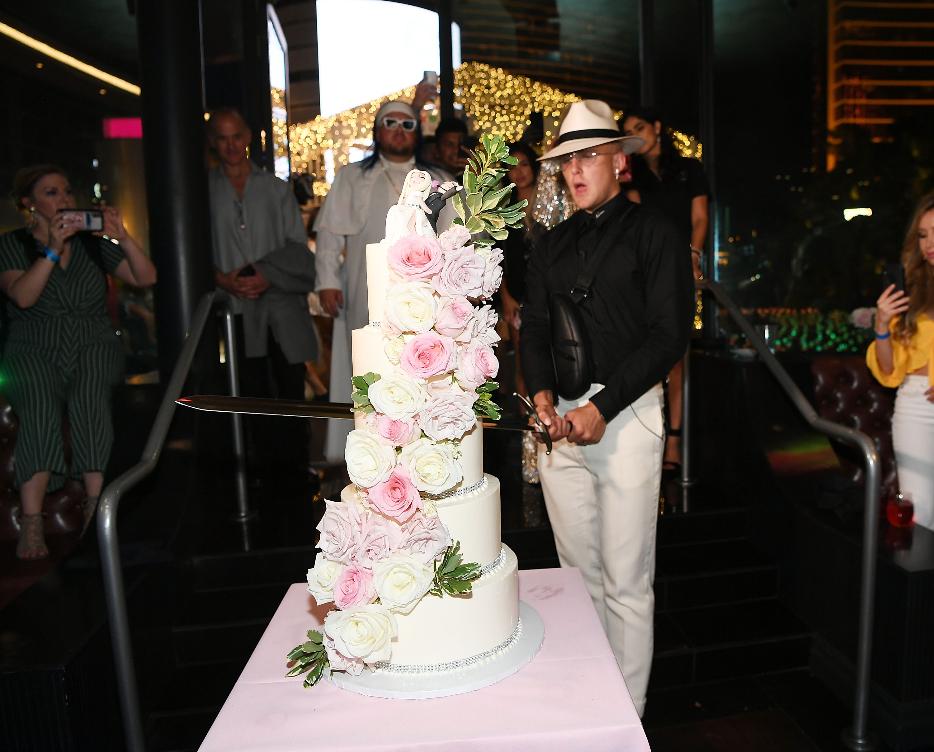 Jake Paul cuts the cake at his wedding reception at Sweet Beginnings in Sugar Factory on July 28, 2019 in Las Vegas, Nevada. (Photo by Denise Truscello/Getty Images for Sugar Factory)