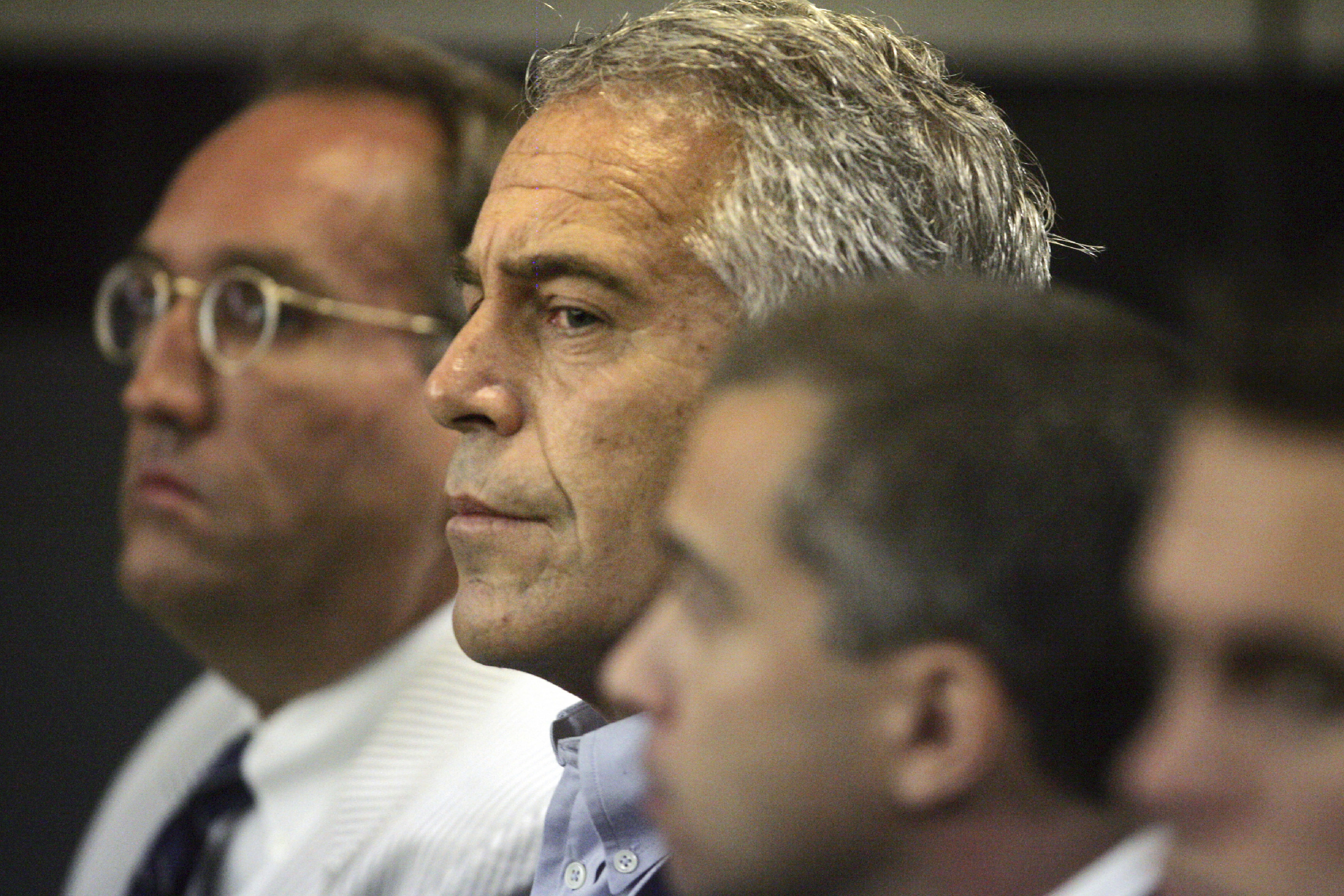 In this July 30, 2008 file photo, Jeffrey Epstein, center, appears in court in West Palm Beach, Fla. The wealthy financier pleaded not guilty in federal court in New York on Monday, July 8, 2019, to sex trafficking charges following his arrest over the weekend. Epstein will have to remain behind bars until his bail hearing on July 15.