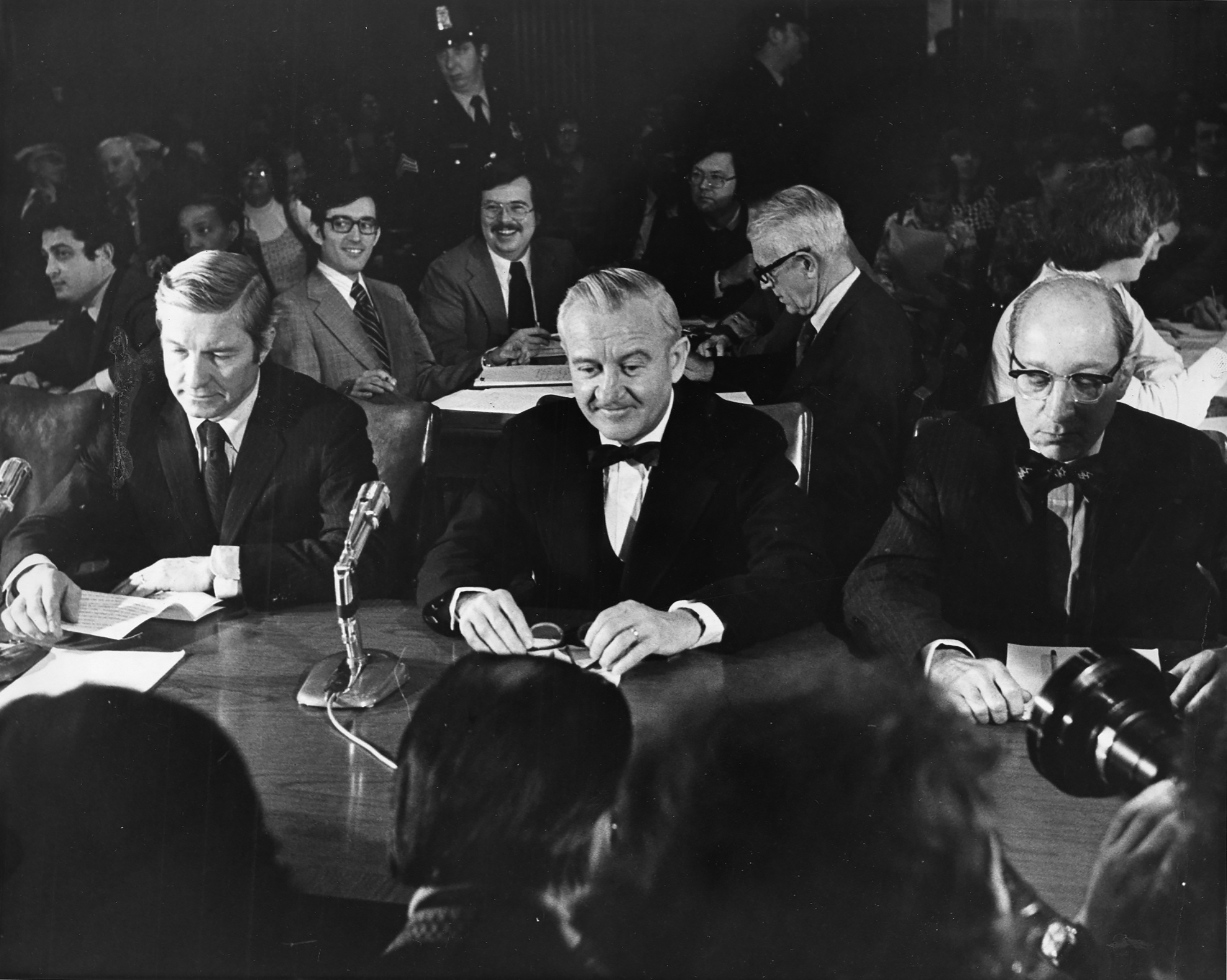 Supreme Court nominee John Paul Stevens is flanked by Sen. Charles Percy, left, and Attorney General Edward Levi at a confirmation hearing before the Senate Judiciary Committee in Washington, D.C., on Dec. 8, 1975.