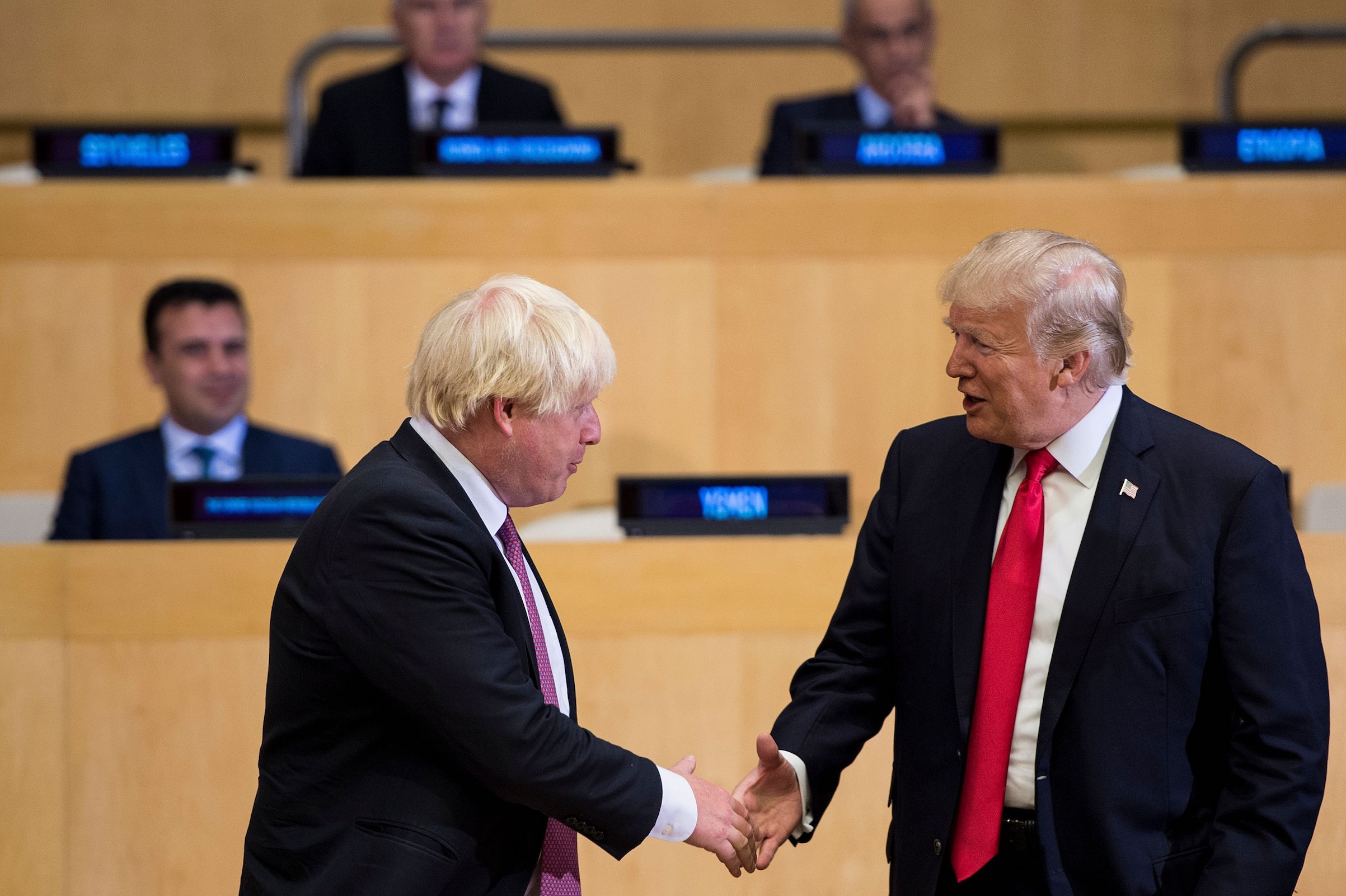 Boris Johnson (L), then British Foreign Secretary, and US President Donald Trump greet before a meeting on United Nations Reform at UN headquarters in New York City on Sept. 18, 2017.