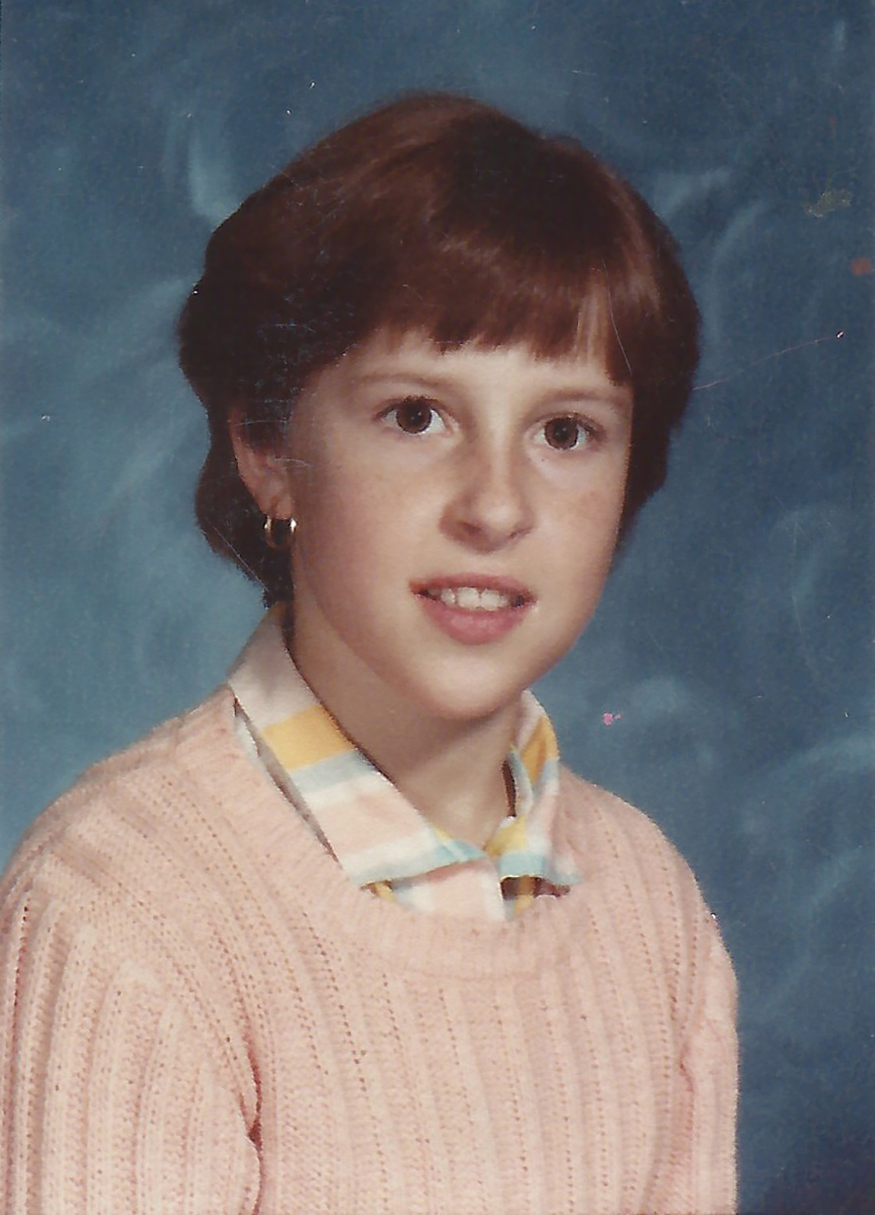 Teristi's school portrait circa 1984, the year she started at Great Lakes Gymnastics.