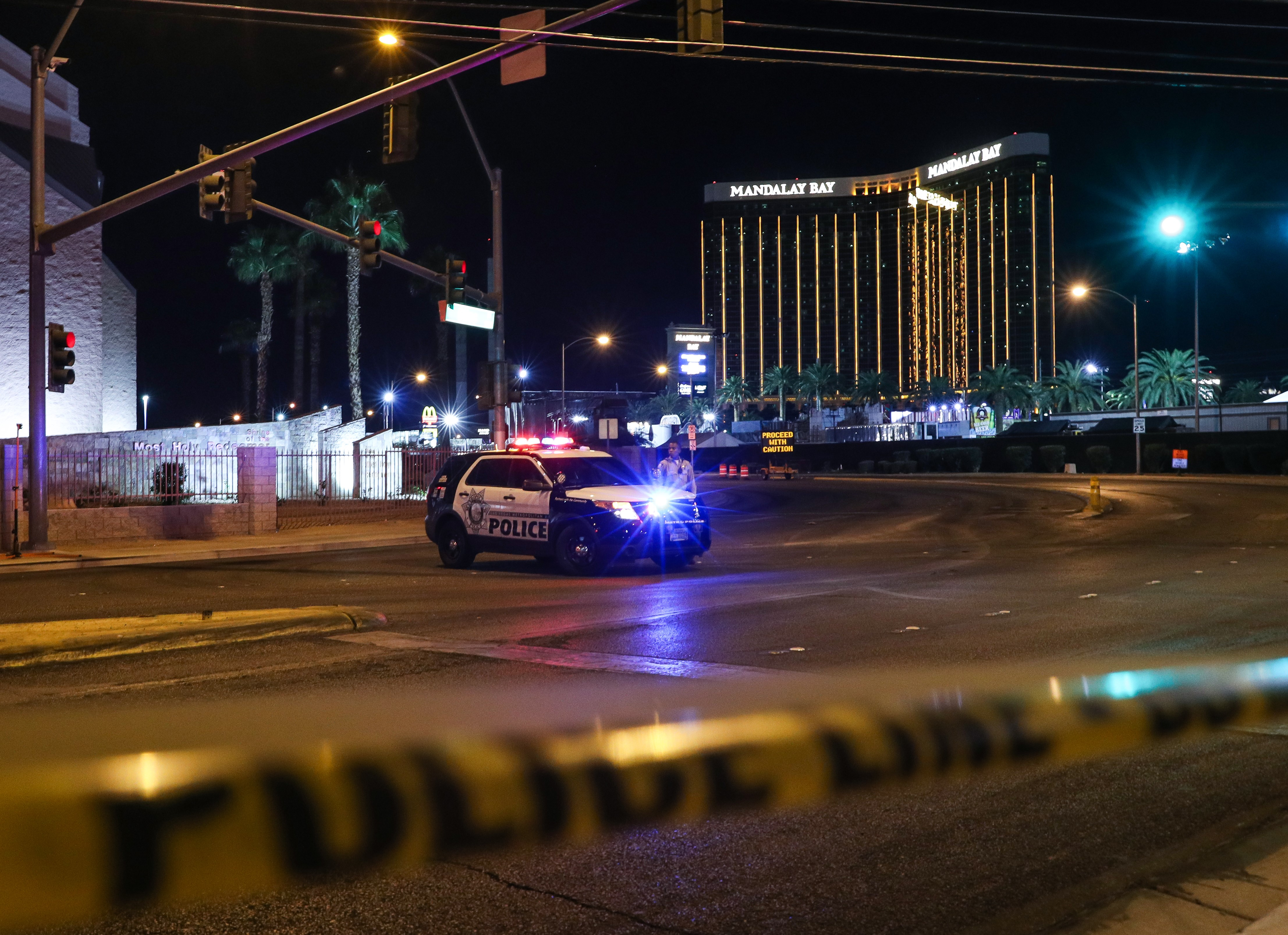 Police block the roads leading to the Mandalay Hotel (background) and inspect the site after a gunman attack in Las Vegas, NV, United States on October 02, 2017.