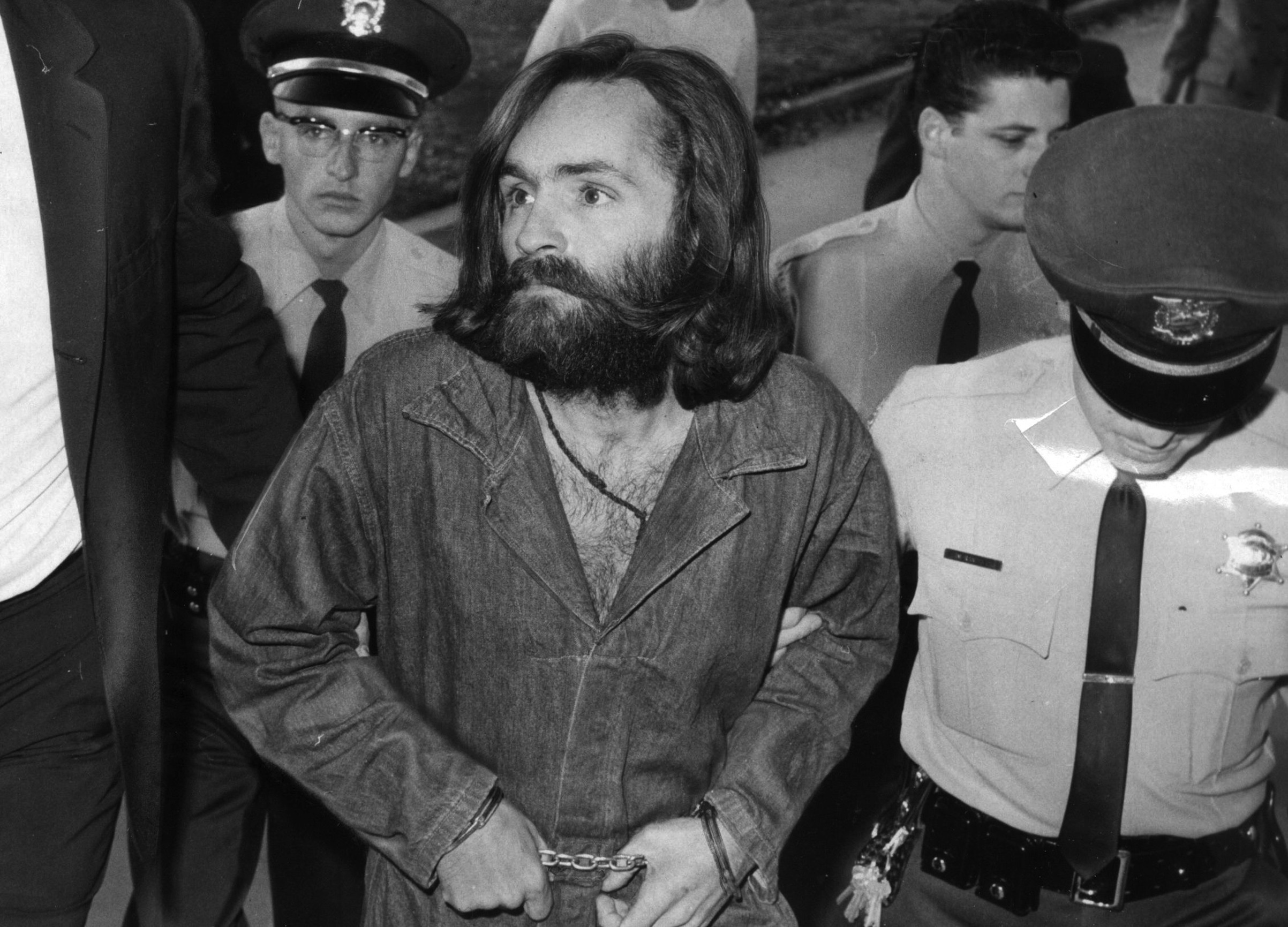 Charles Manson is escorted to court for a preliminary hearing on Dec. 3, 1969, in Los Angeles