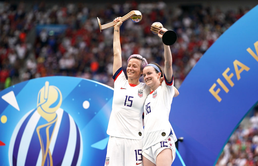 USA's Megan Rapinoe (left) and Rose Lavelle celebrate with the FIFA Women's World Cup Trophy after the final whistle USA v. Netherlands in Lyon, France, on July 7, 2019.
