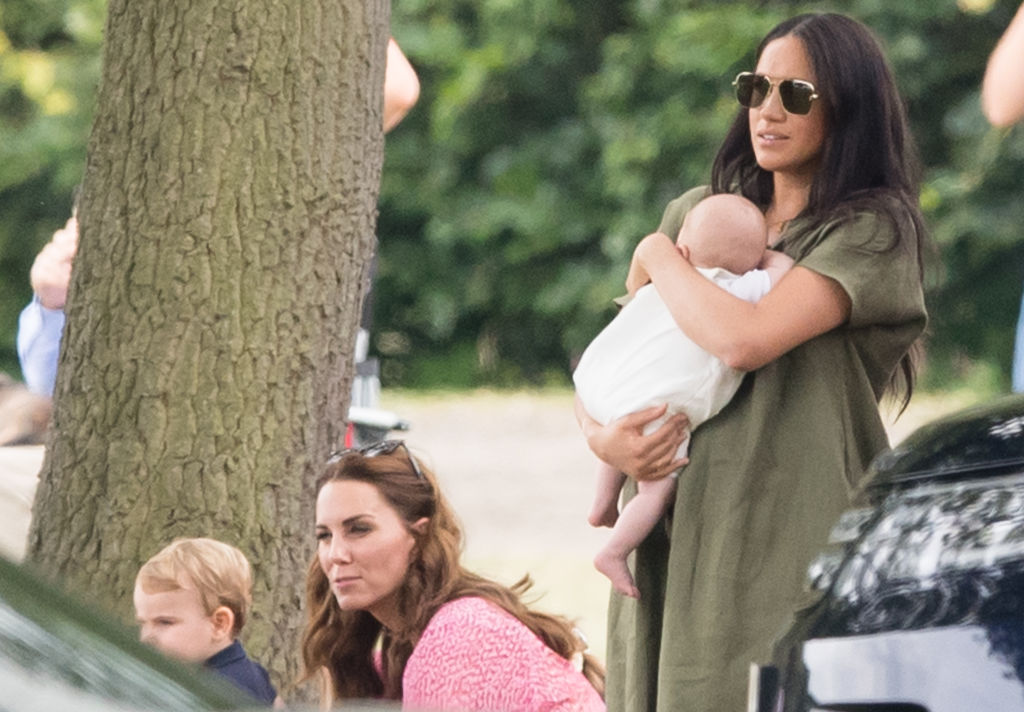 Meghan, Duchess of Sussex and Archie Harrison Mountbatten-Windsor, Catherine, Duchess of Cambridge and Prince Louis attend The King Power Royal Charity Polo Day at Billingbear Polo Club on July 10, 2019 in Wokingham, England.