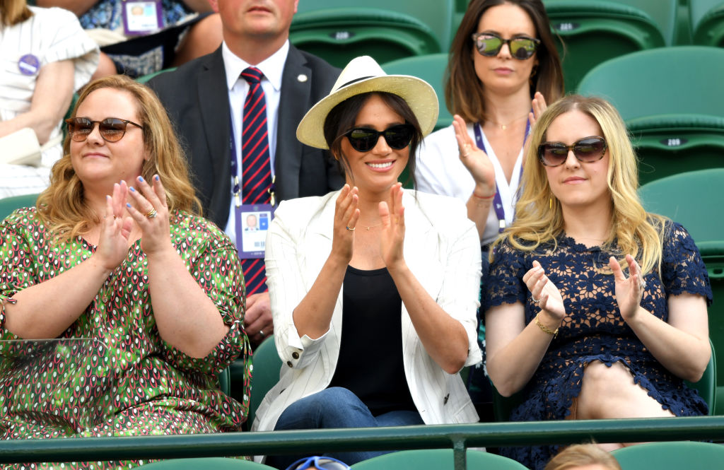 Meghan, Duchess of Sussex (C) attends day 4 of the Wimbledon Tennis Championships at the All England Lawn Tennis and Croquet Club on July 04, 2019 in London, England.