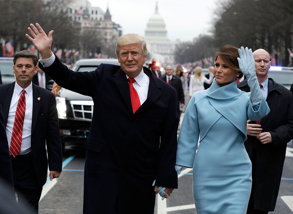 U.S. President Donald Trump waves to supporters along the parade route with first lady Melania Trump and son Barron Trump after being sworn in at the 58th Presidential Inauguration January 20, 2017 in Washington, D.C.