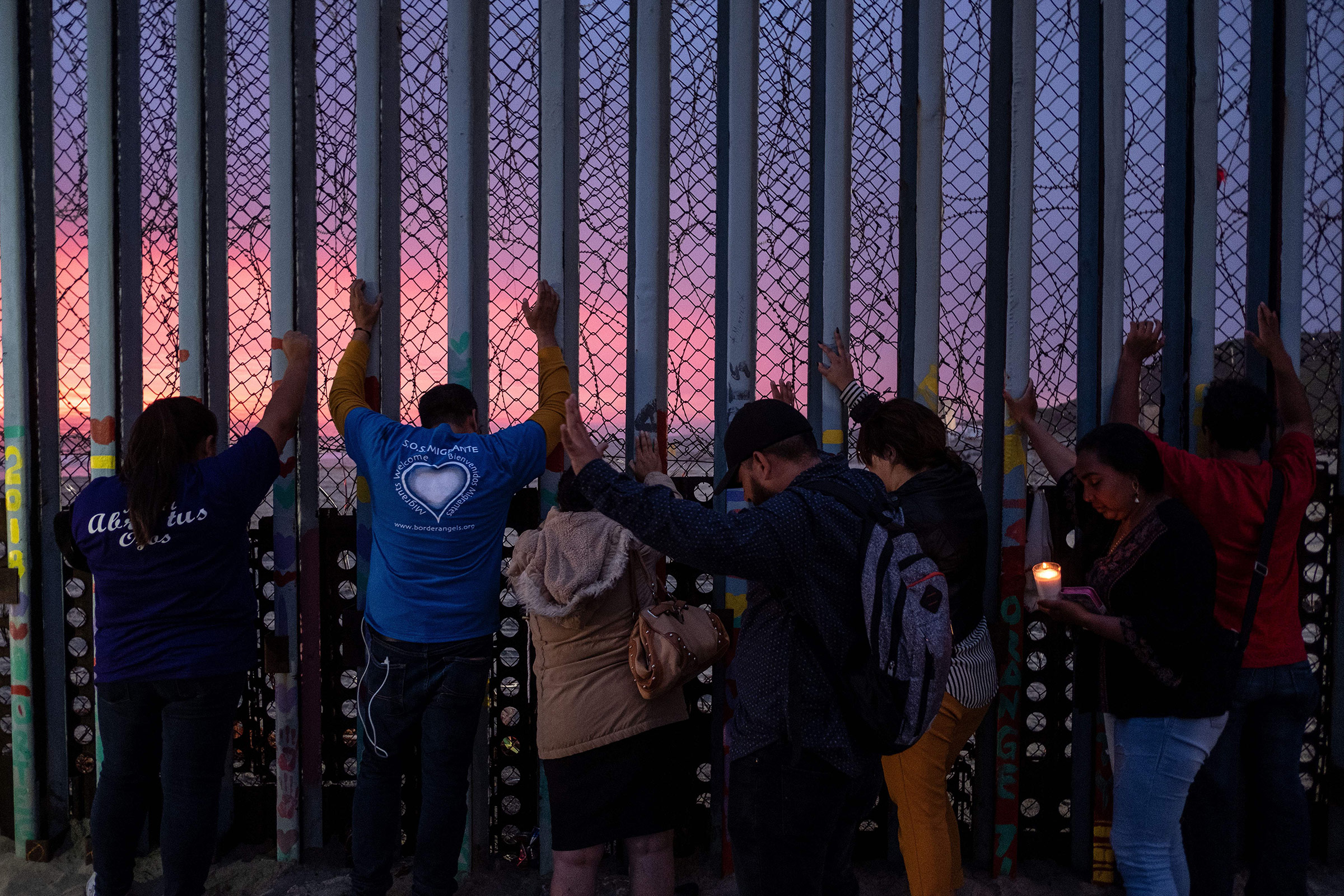 Migrants, advocates and attendees take part in an event called  Clamor for those who didn't achieve the dream  at the U.S.-Mexico border in Playas de Tijuana, Baja California state, Mexico, on June 29, 2019.