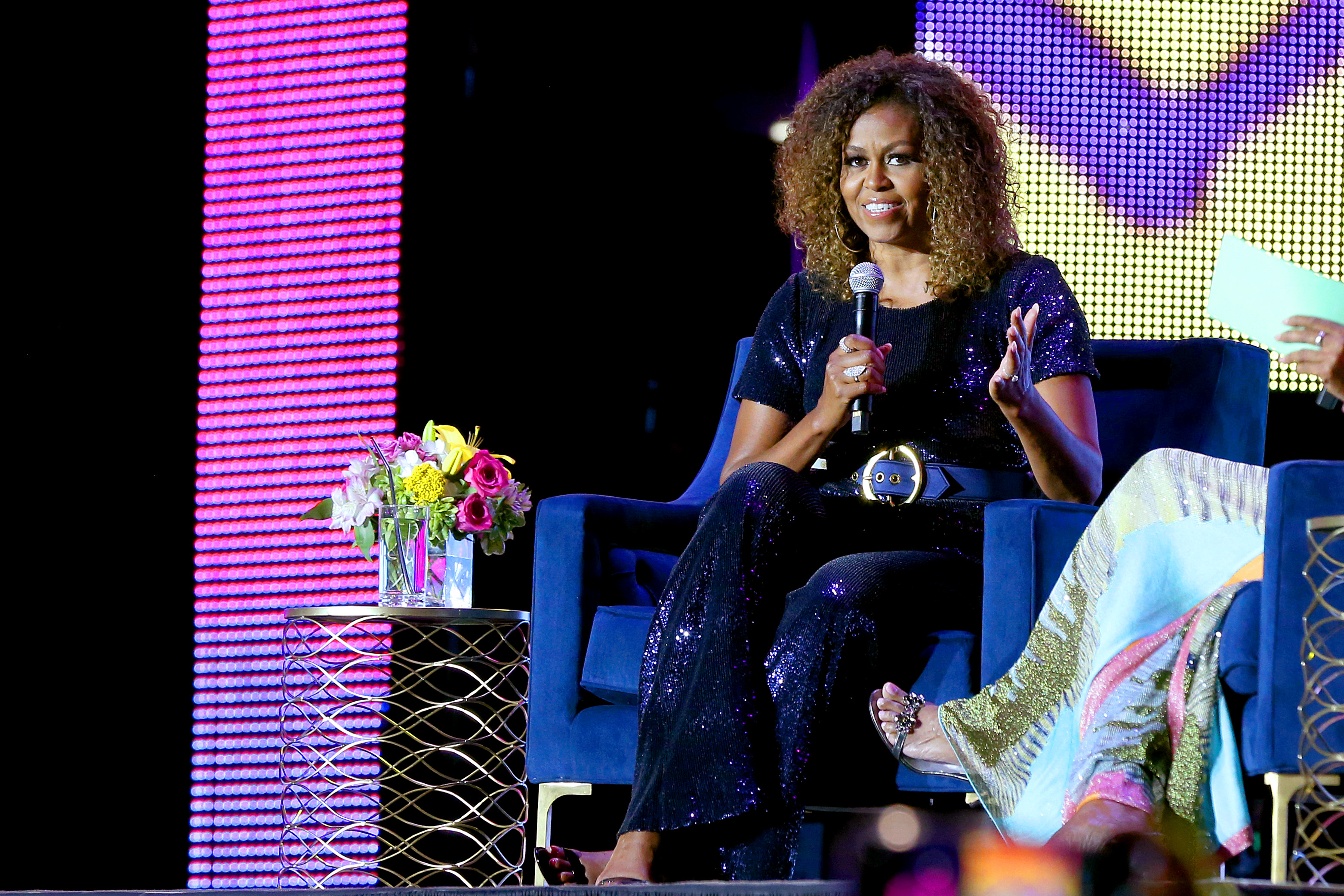 NEW ORLEANS, LOUISIANA - JULY 06: Michelle Obama speaks onstage during the 2019 ESSENCE Festival Presented By Coca-Cola at Louisiana Superdome on July 06, 2019 in New Orleans, Louisiana. (Photo by Bennett Raglin/Getty Images for ESSENCE)
