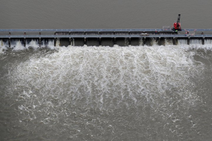 Workers open bays of the Bonnet Carre Spillway, to divert rising water from the Mississippi River to Lake Pontchartrain, upriver from New Orleans, in Norco, La., on May 10, 2019.