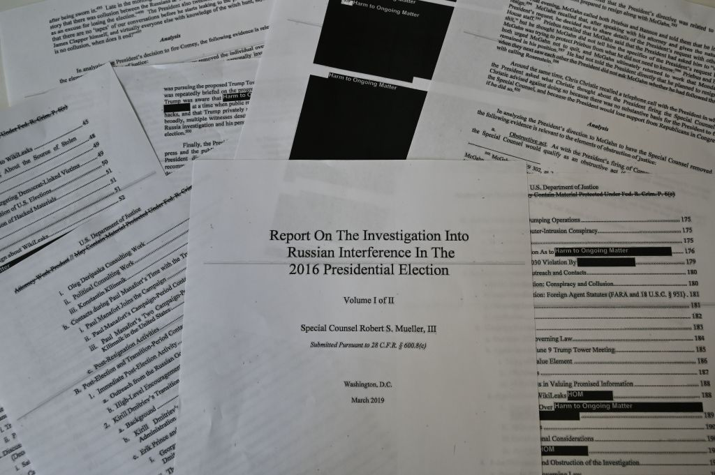 An illustration shows printed pages of the redacted Mueller Report at an office on April 18, 2019, in Washington, D.C.