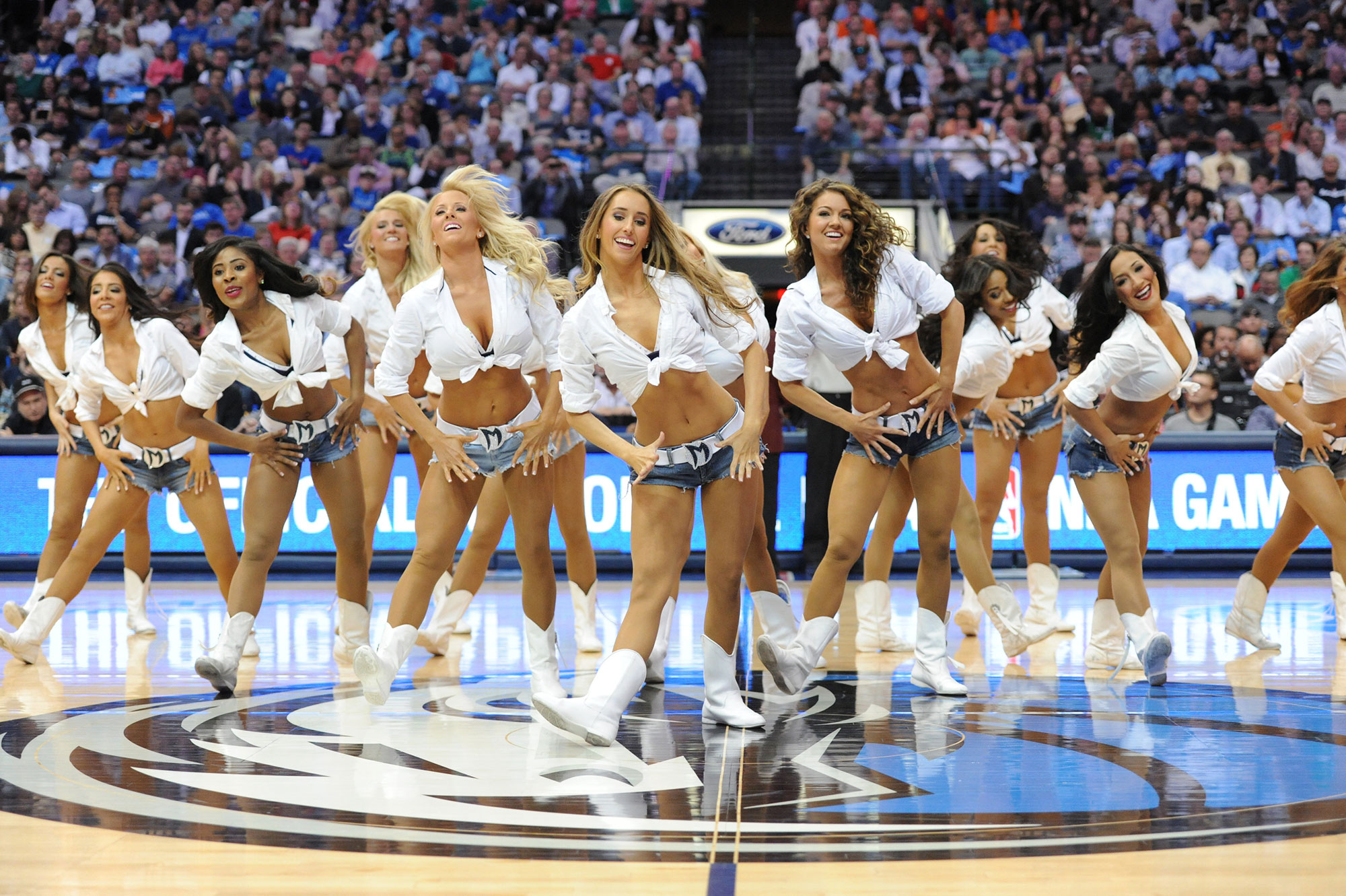 The Mavericks Dancers perform during an NBA game between the San Antonio Spurs and the Dallas Mavericks at the American Airlines Center in Dallas, TX on April 10, 2014.