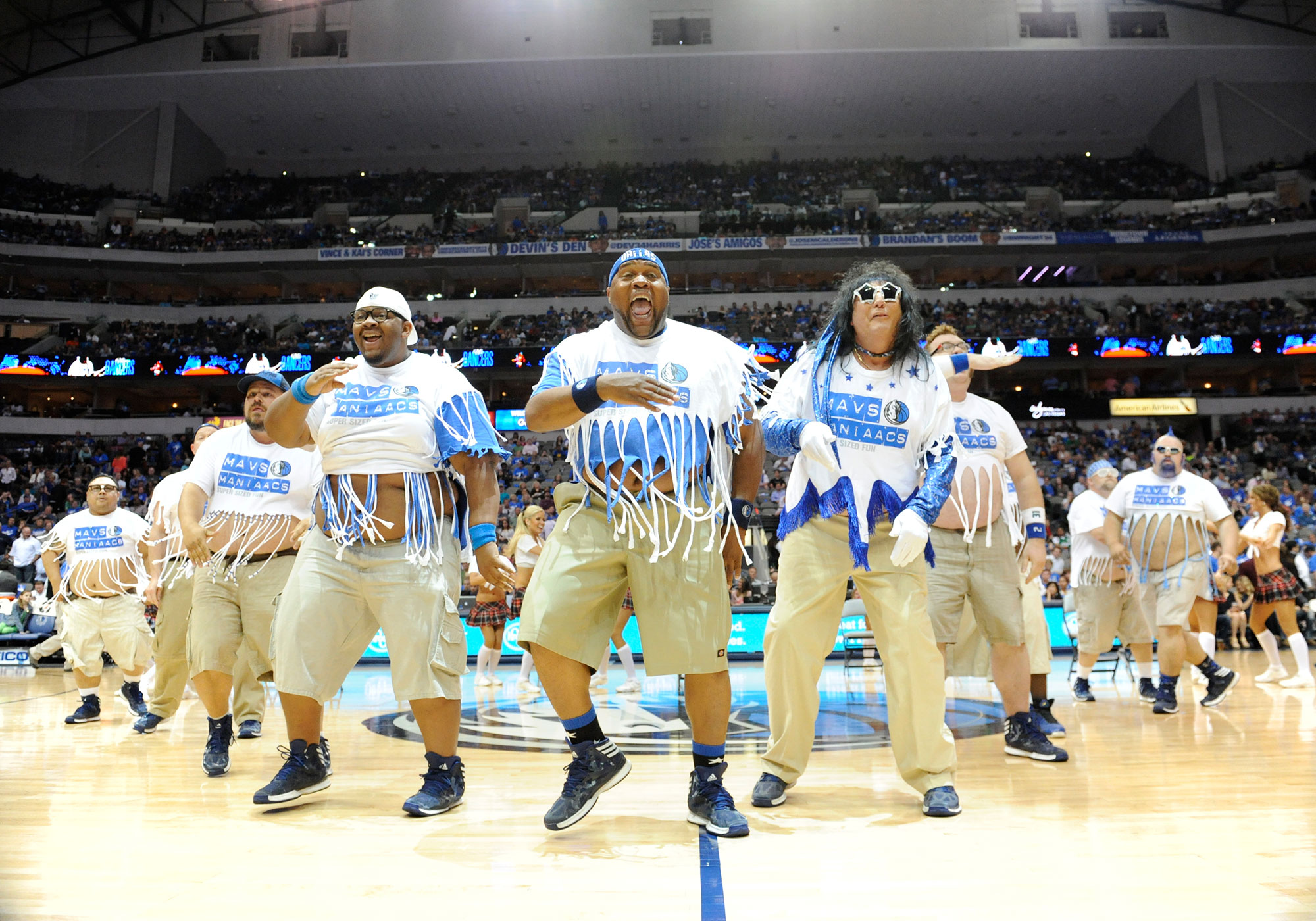 The Mavs ManiAACs perform during an NBA game between the Golden State Warriors and the Dallas Mavericks at the American Airlines Center in Dallas, TX on April 1, 2014.