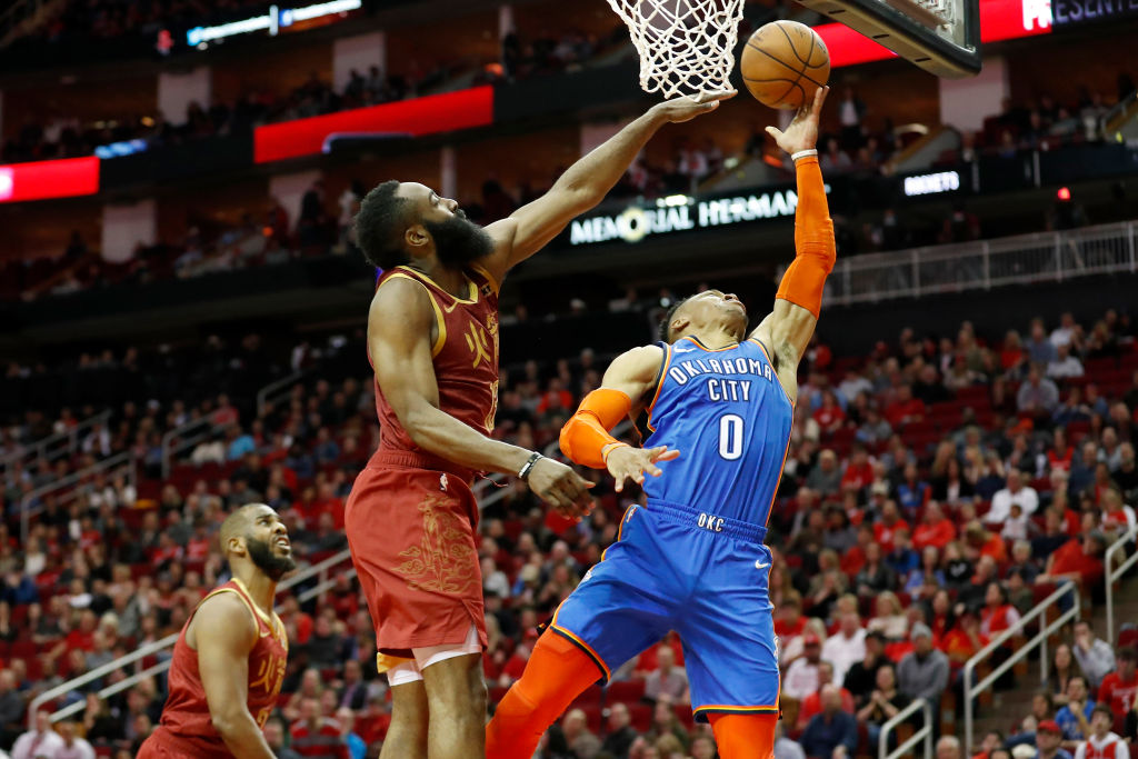 Russell Westbrook of the Oklahoma City Thunder goes up for a shot defended by James Harden  of the Houston Rockets in Houston, TX on Feb. 9, 2019.