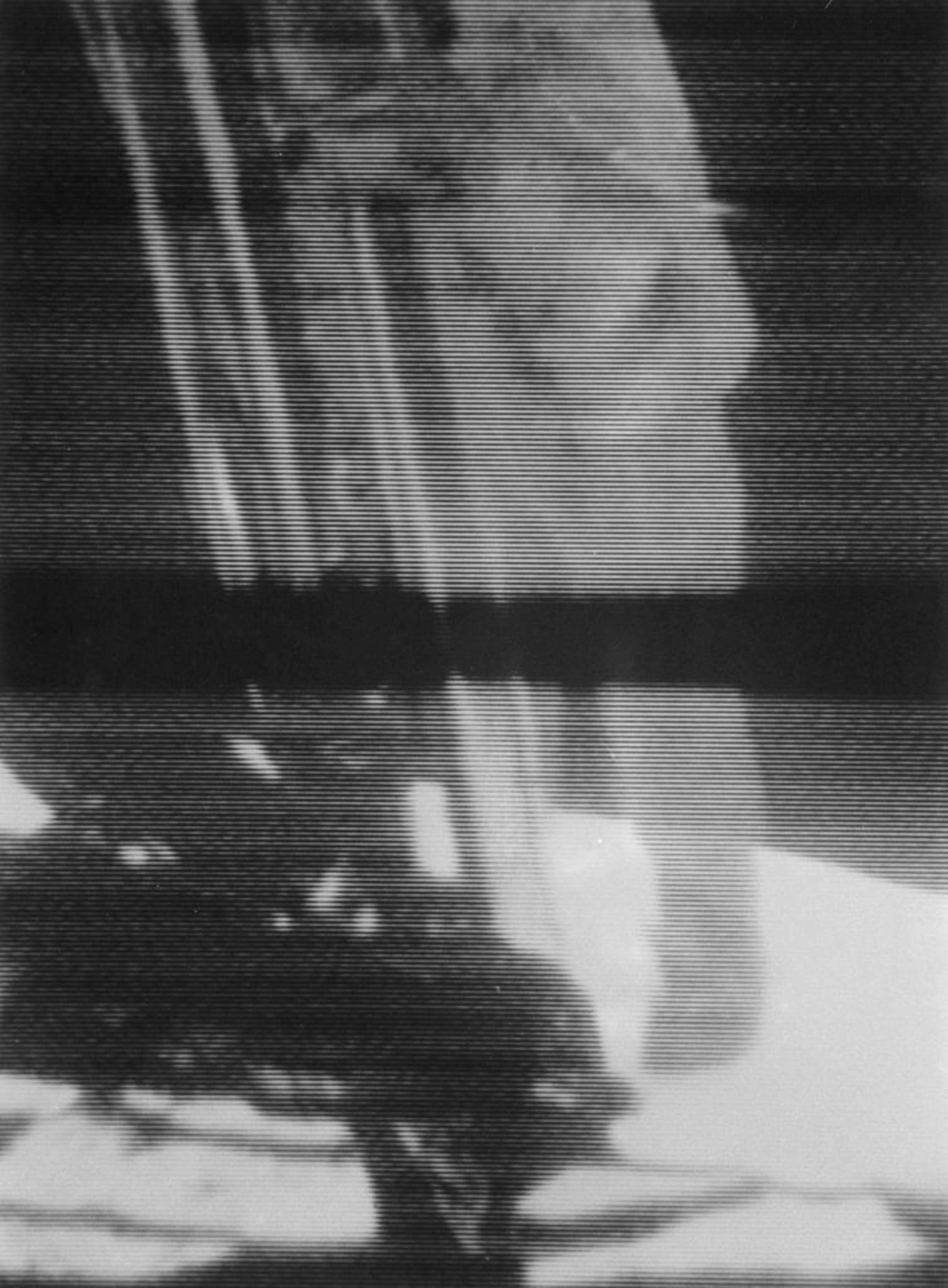 A screenshot from video footage of Commander Neil Armstrong climbing down the ladder of the Lunar Module (LM) the 'Eagle,' to become the first man to set foot on the Moon on July 20, 1969, during NASA's Apollo 11 lunar landing mission.