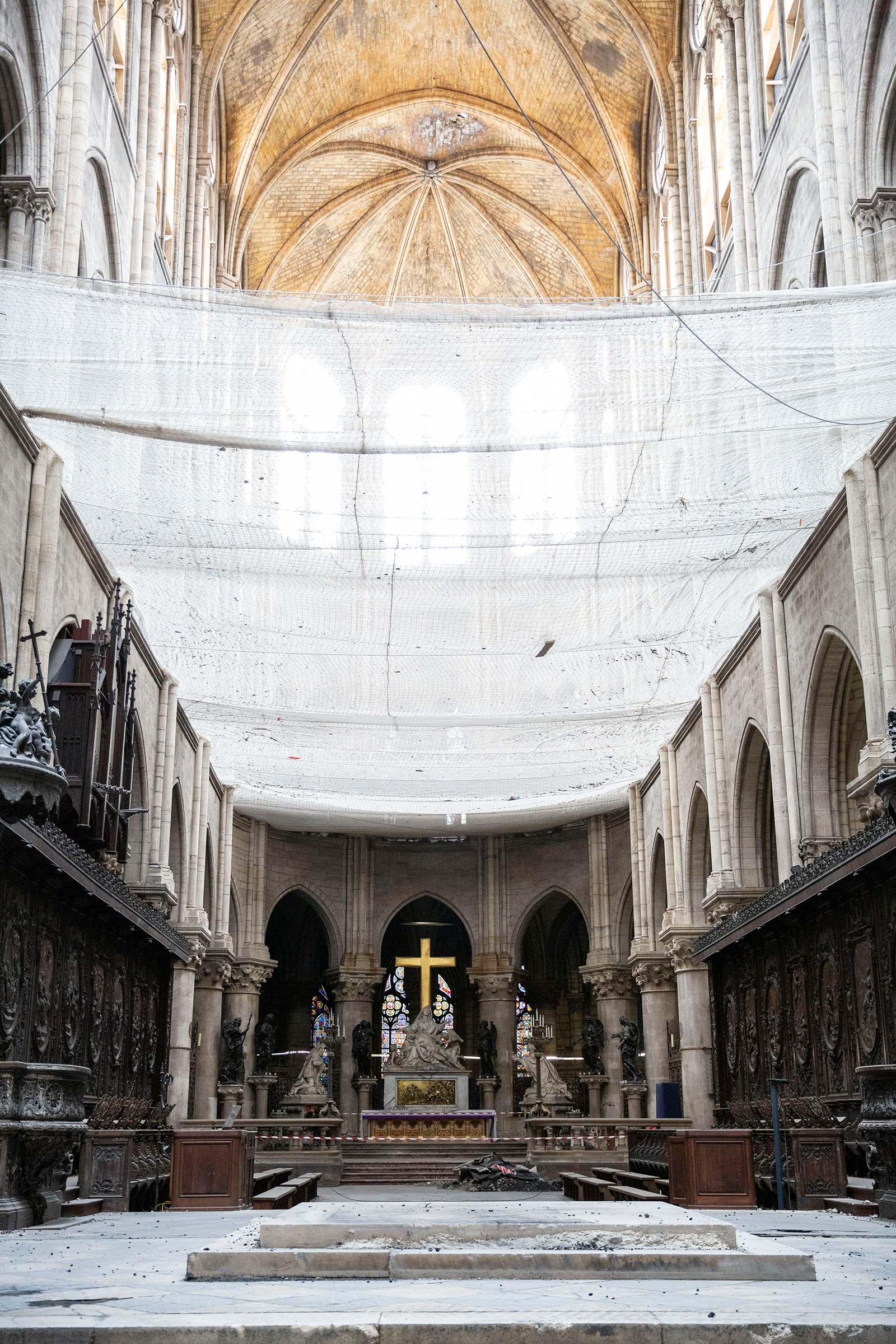 Netting installed to catch falling debris inside Notre Dame on July 11.