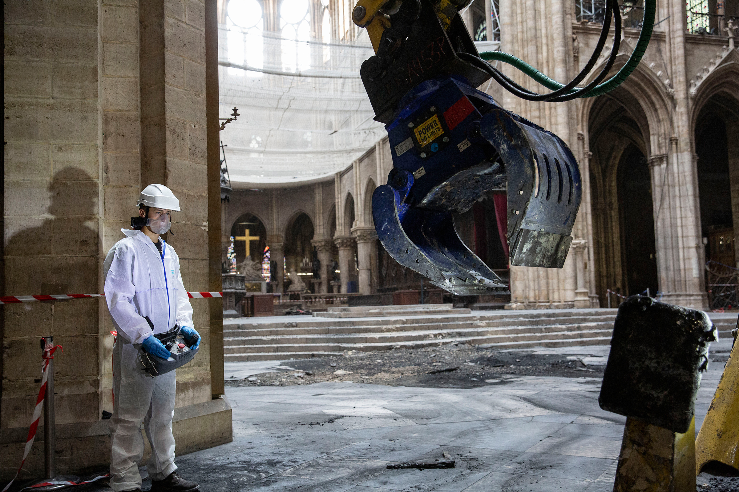 A technician clears rubble inside the cathedral on July 11.