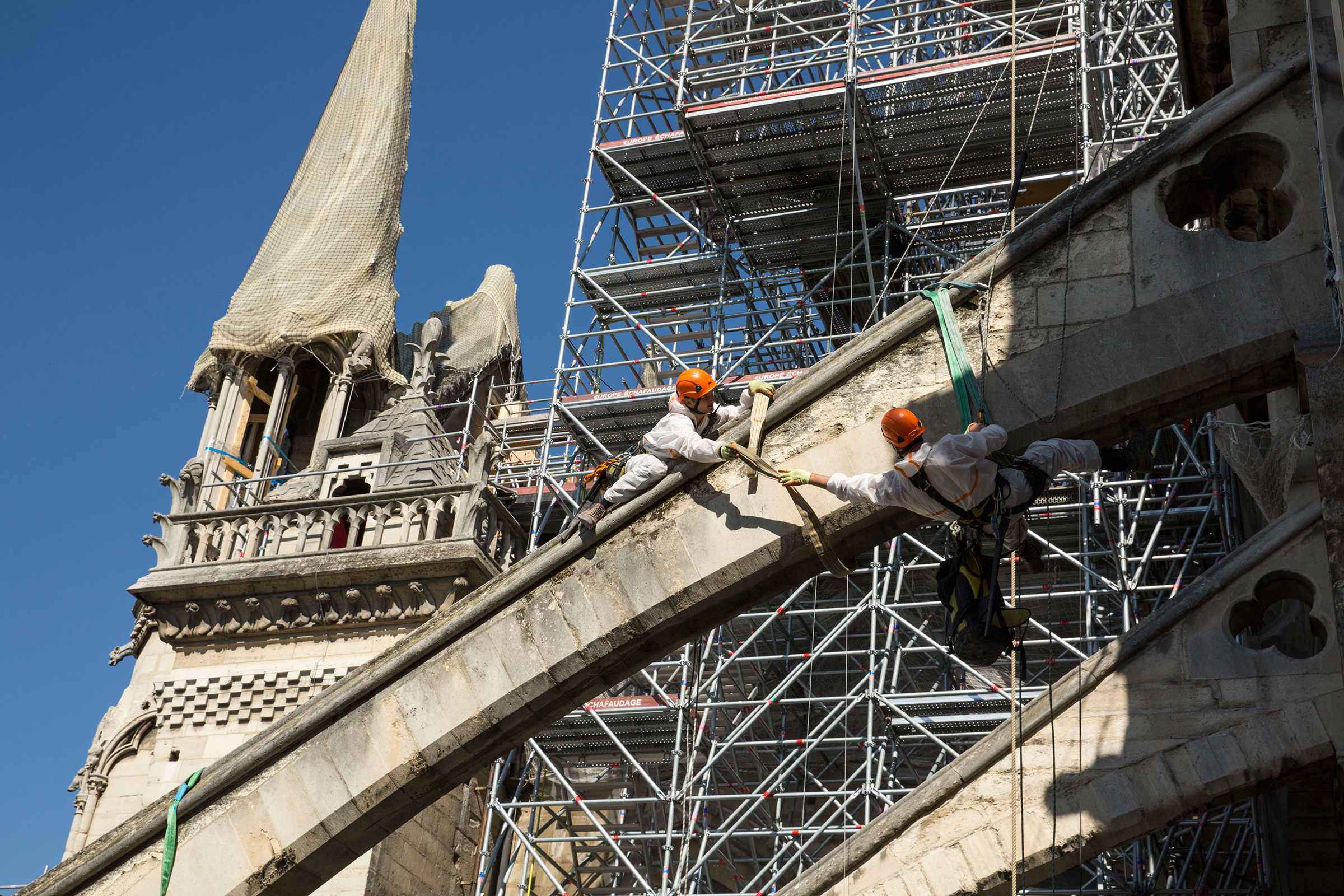 Workers prepare the flying buttresses, where wooden arches will be installed to support the structure.