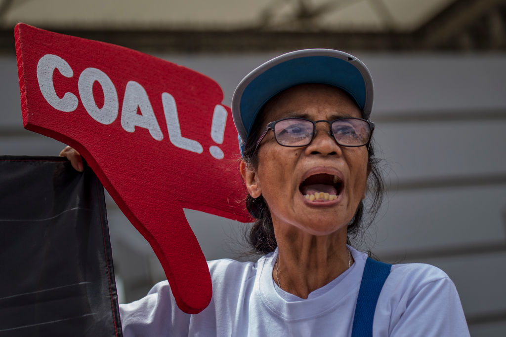 Environmental activists take part in a protest calling on the Group of 20 nations to end funding for coal and fossil fuels, in Manila, Philippines on June 26, 2019.