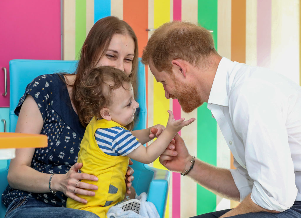 Prince Harry, Duke of Sussex plays with one year old Noah Nicholson, during a visit to Sheffield Children's Hospital on July 25, 2019 in Sheffield, England.