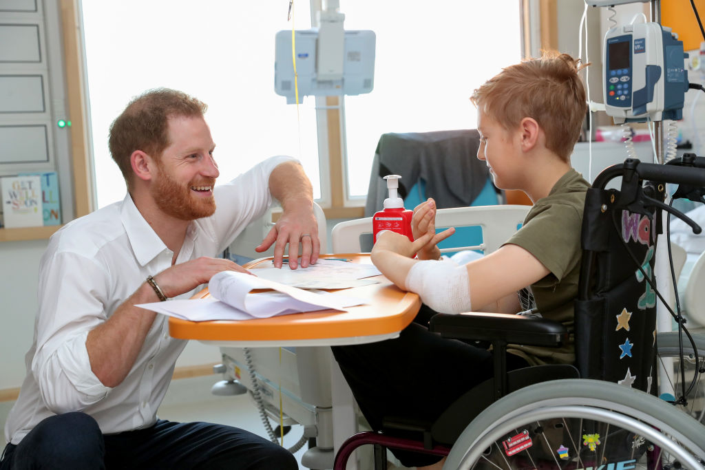 Prince Harry, Duke of Sussex speaks with 11 year old Heath Keighley during a visit to Sheffield Children's Hospital on July 25, 2019 in Sheffield, England.