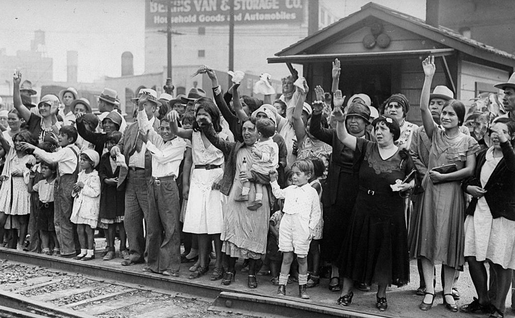 Relatives and friends wave goodbye to a train carrying 1,500 people being expelled from Los Angeles back to Mexico on Aug. 20, 1931.