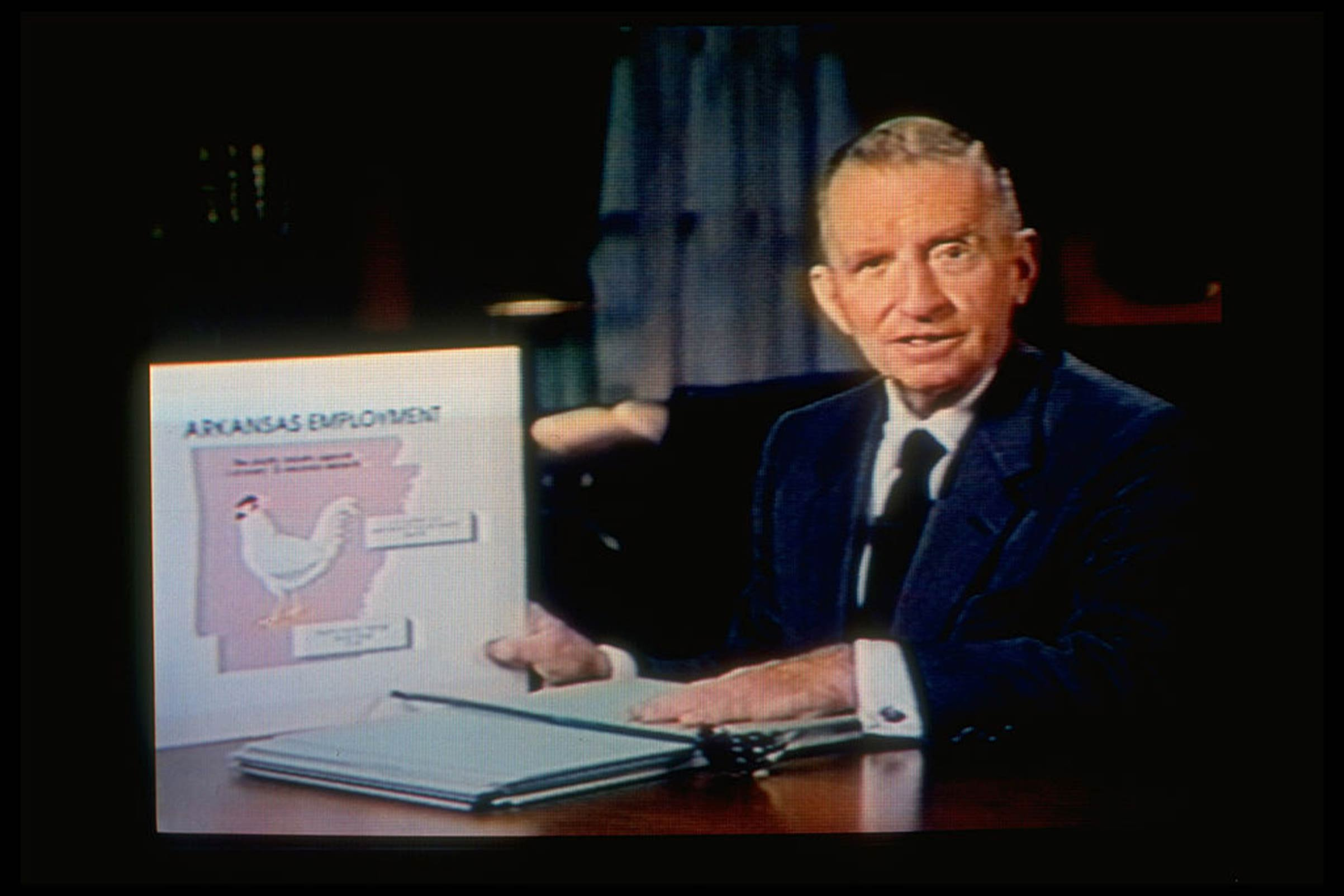 Texas magnate Ross Perot displaying an Arkansas state employment record chart to attack candidate Bill Clinton in a self-financed TV program that aired on Nov. 1, 1992.