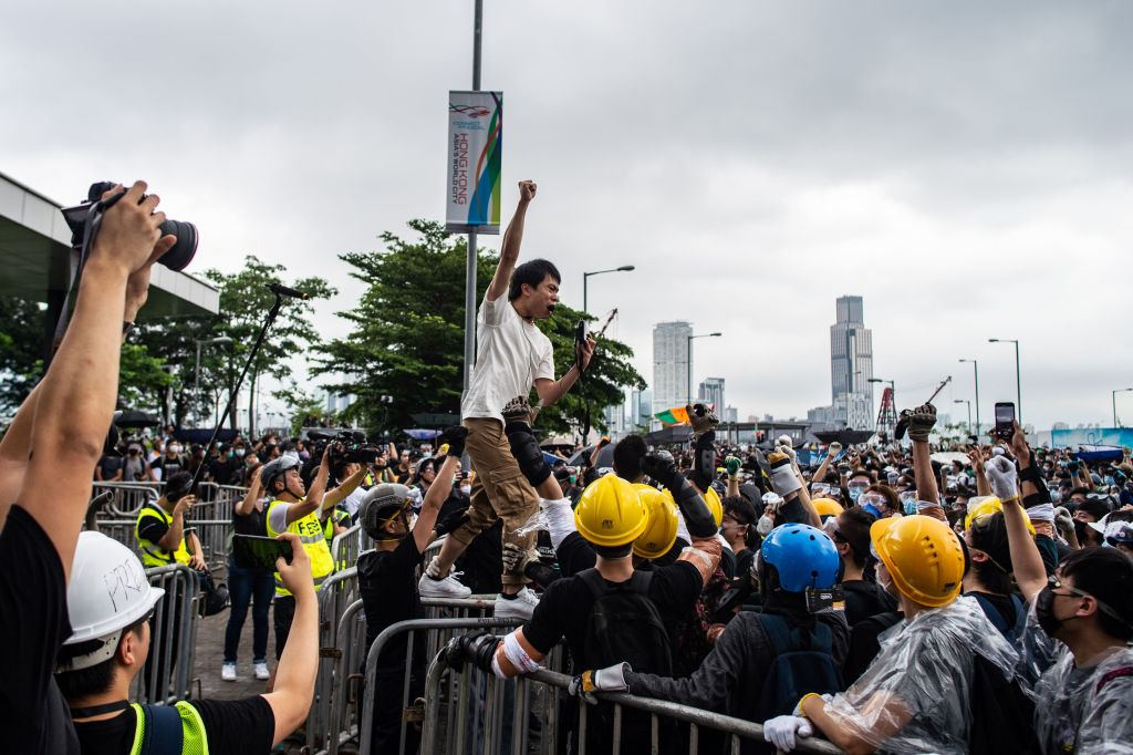 Lawmaker Roy Kwong (C) chants slogans as protesters gather outside the Legislative Council in Hong Kong on June 12, 2019.