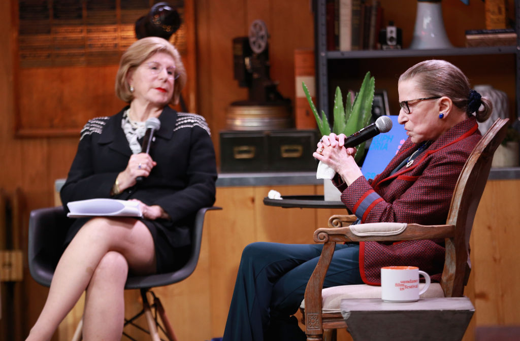 NPR legal affairs correspondent Nina Totenberg (L) and Associate Justice of the Supreme Court of the United States Ruth Bader Ginsburg speak during the 2018 Sundance Film Festival at Filmmaker Lodge on January 21, 2018 in Park City, Utah.