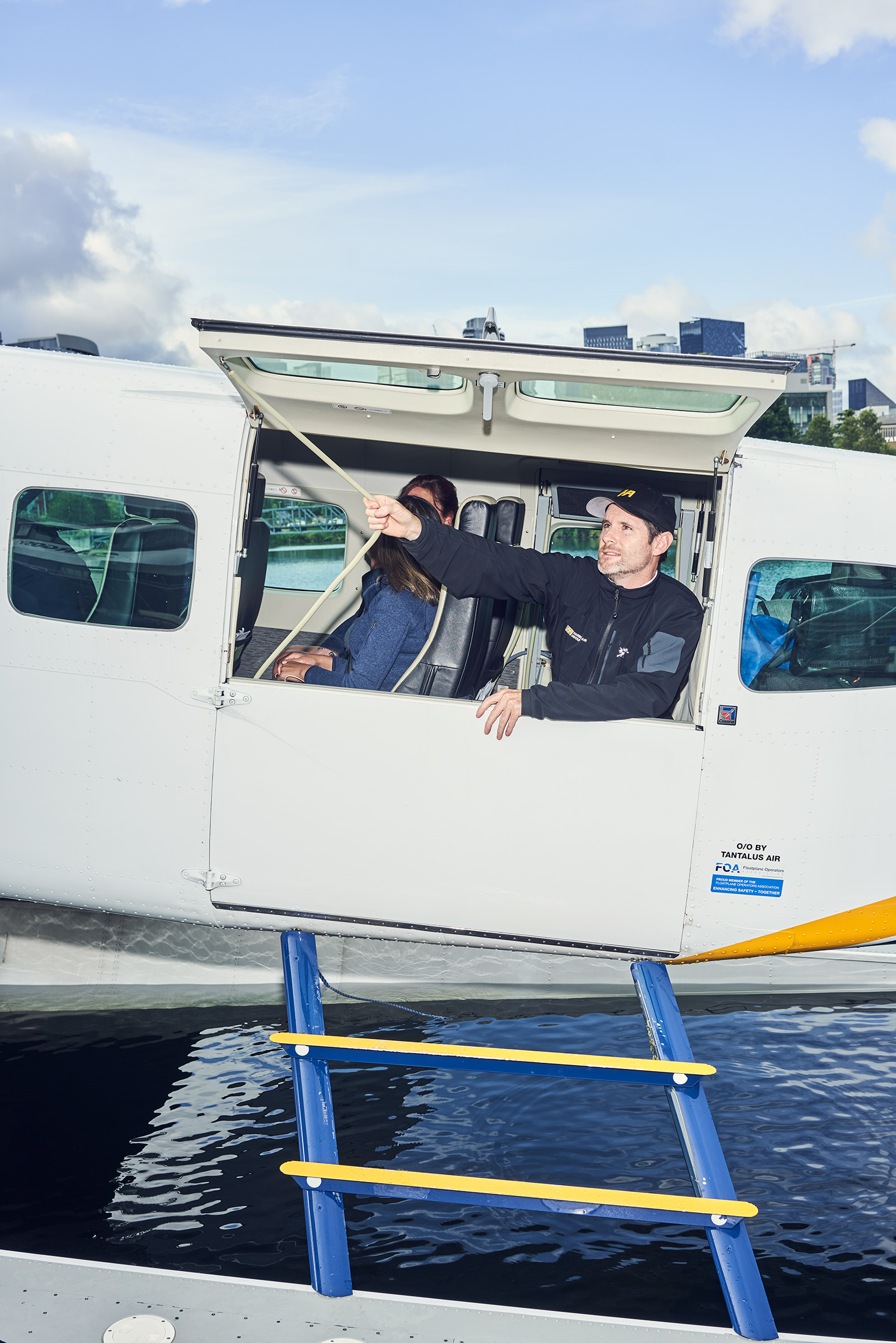 A Harbour Air crew member prepares for take-off on a seaplane flying from Seattle to Vancouver on July 11. When the Vancouver-Seattle route launched last year, tech companies bought tickets in bulk so their employees could go back and forth between Canada and the United States easily.