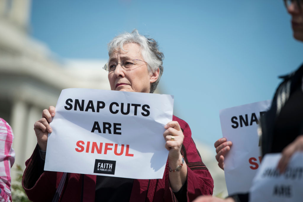 Demonstrators urge lawmakers to reject proposed cuts to the Supplemental Nutrition Assistance Program (SNAP) on May 7, 2018.