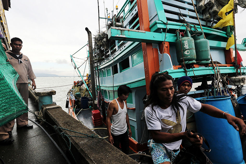 Fishermen disembark from their fishing boat at Songkhla port in Songkhla, Thailand, on Wednesday, Dec. 23, 2015.