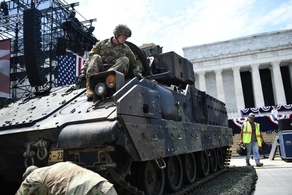 Members of the US military are seen next to a Bradley Fighting Vehicle as preparations are made for the  Salute to America  Fourth of July event with US President Donald Trump at the Lincoln Memorial on the National Mall in Washington, DC, July 3.