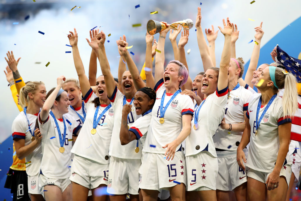 Megan Rapinoe and USA players celebrate as they lift the trophy during the 2019 FIFA Women's World Cup France Final match between The United States of America and The Netherlands at Stade de Lyon on July 7, 2019 in Lyon, France.