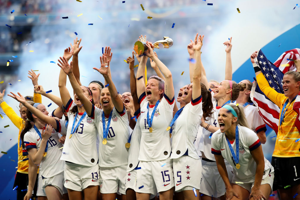 USA players celebrate as they lift the trophy during the 2019 FIFA Women's World Cup France Final match between The United States of America and The Netherlands at Stade de Lyon on July 7, 2019 in Lyon, France.