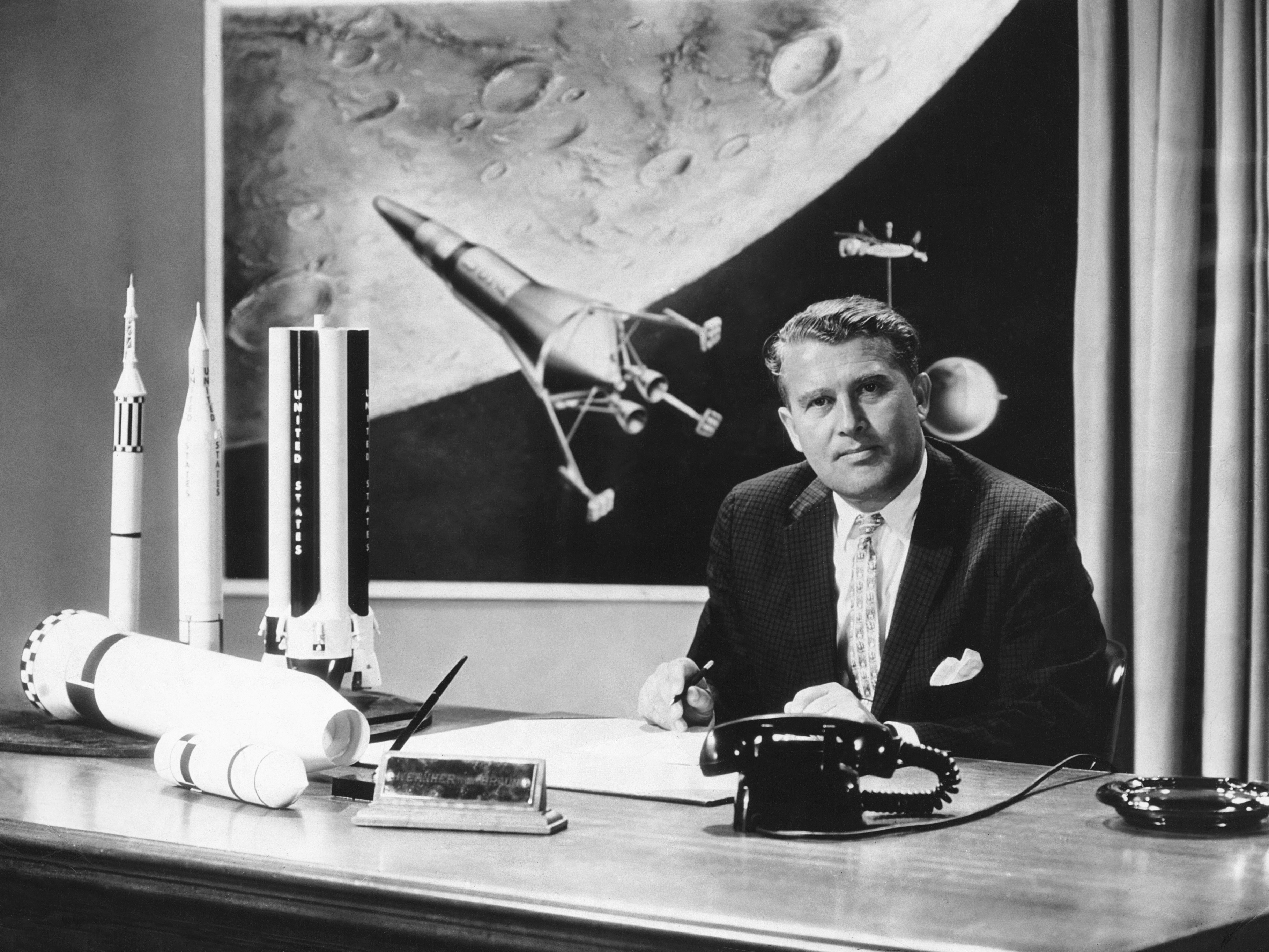 Werner von Braun (1912-1977), the German-born American rocket engineer with model rockets.