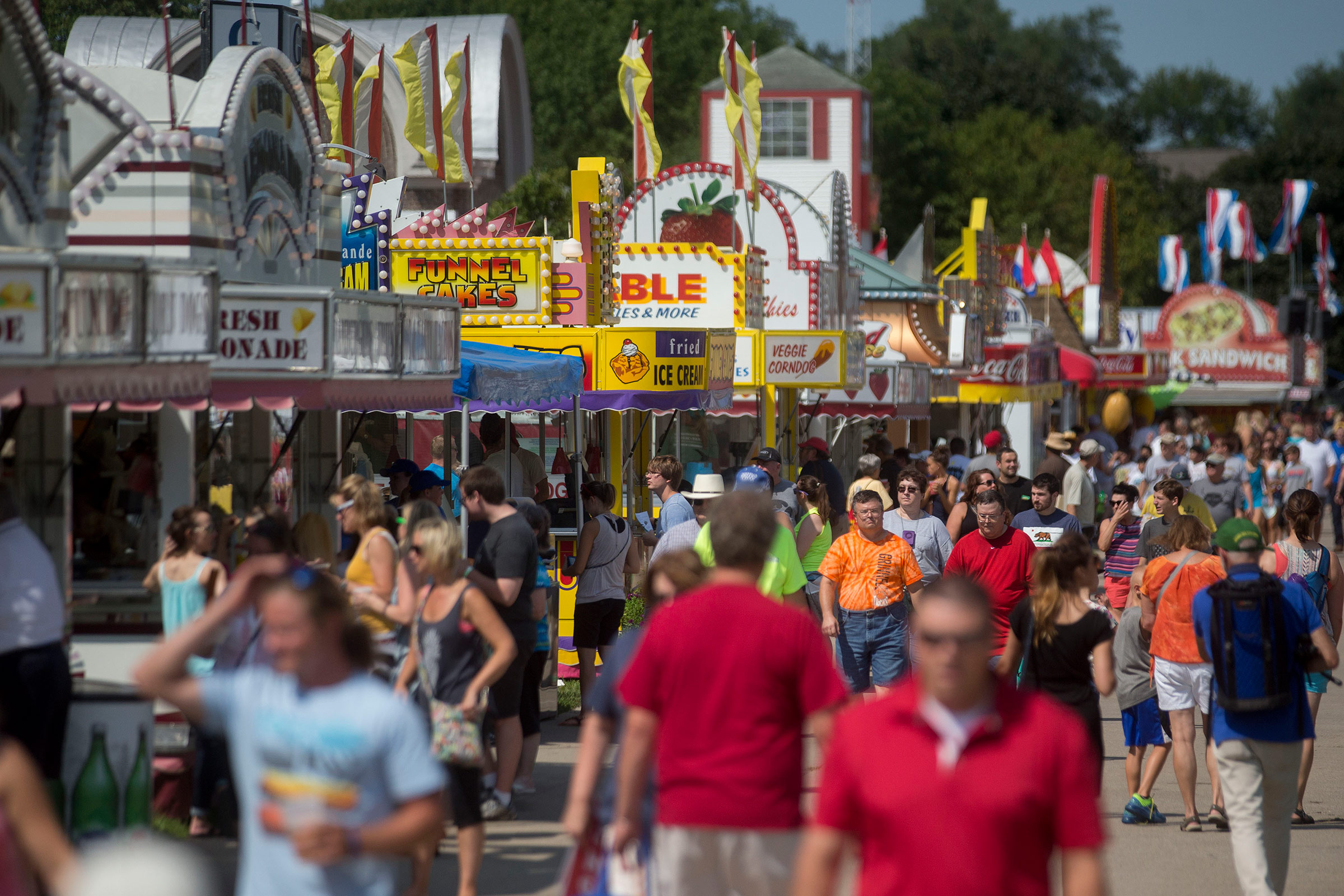 Attendees walk past food stands at the Iowa State Fair in Des Moines, Iowa, U.S. in August 2015.