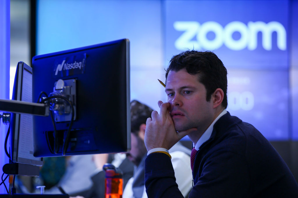 A trader work after the Nasdaq opening bell ceremony on April 18, 2019 in New York City. The video-conferencing software company Zoom announced its IPO priced at $36 per share, at an estimated value of $9.2 billion.