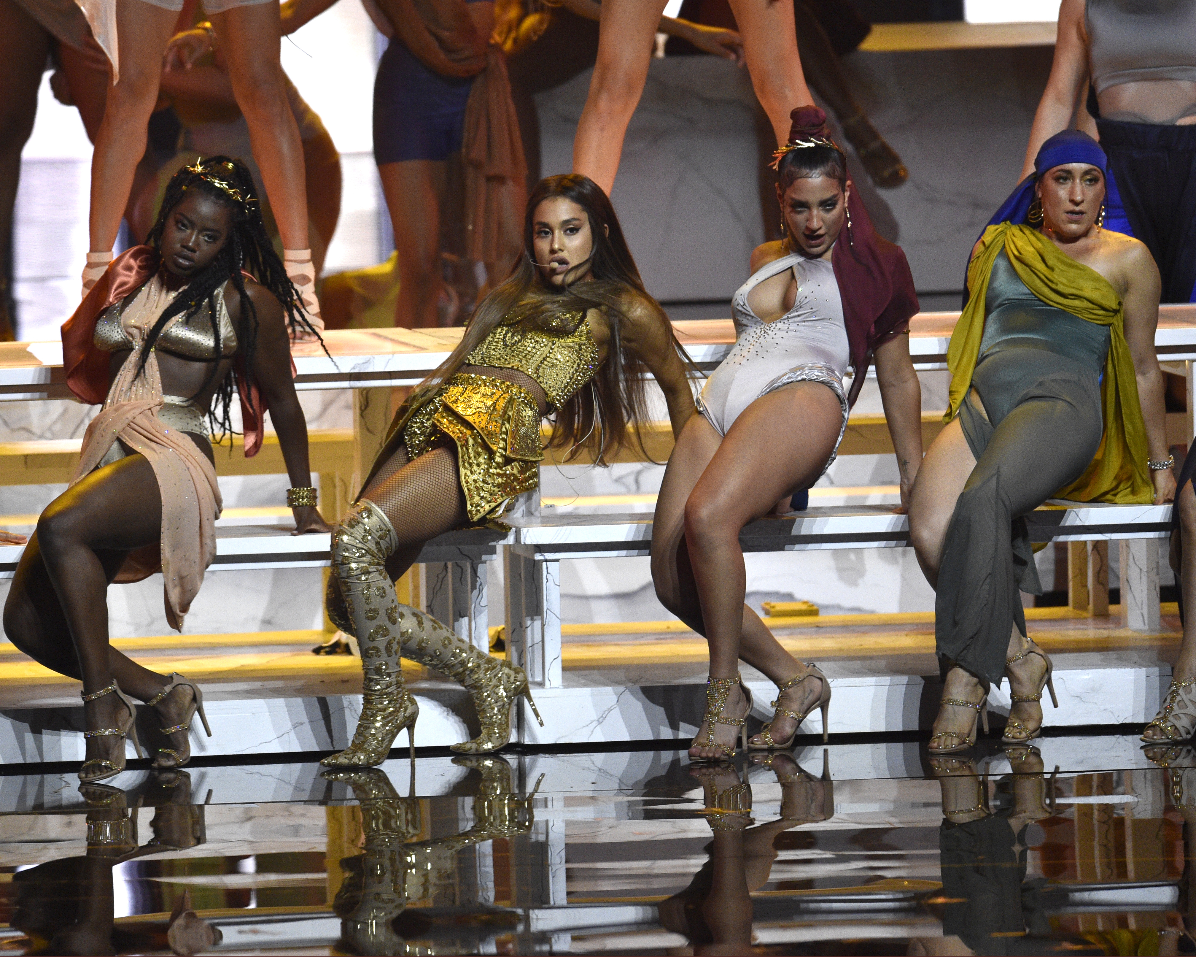 Ariana Grande, second left, performs 'God is a woman' at the MTV Video Music Awards at Radio City Music Hall on Monday, Aug. 20, 2018, in New York.