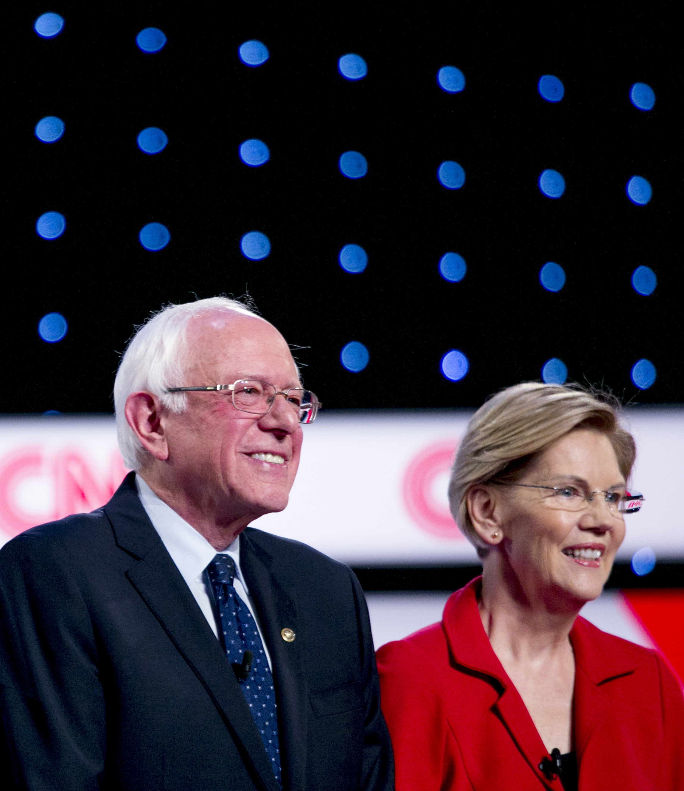 2020 Democratic Presidential candidates Senator Bernie Sanders and Senator Elizabeth Warren stand on stage during the Democratic presidential candidate debate in Detroit, Michigan, U.S., on Tuesday, July 30, 2019.