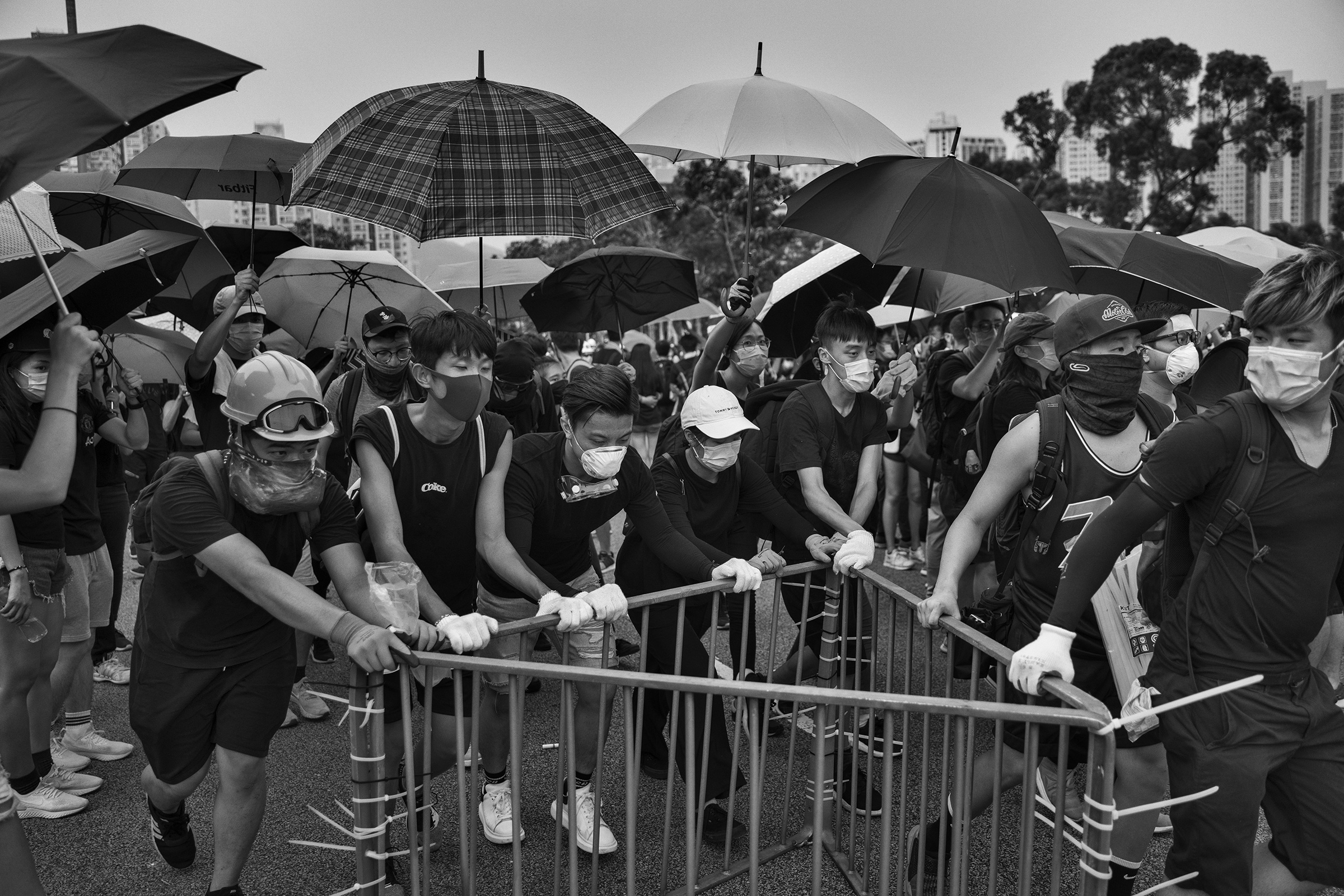 Antigovernment protesters block a road near the Tai Po police station on Aug. 10.