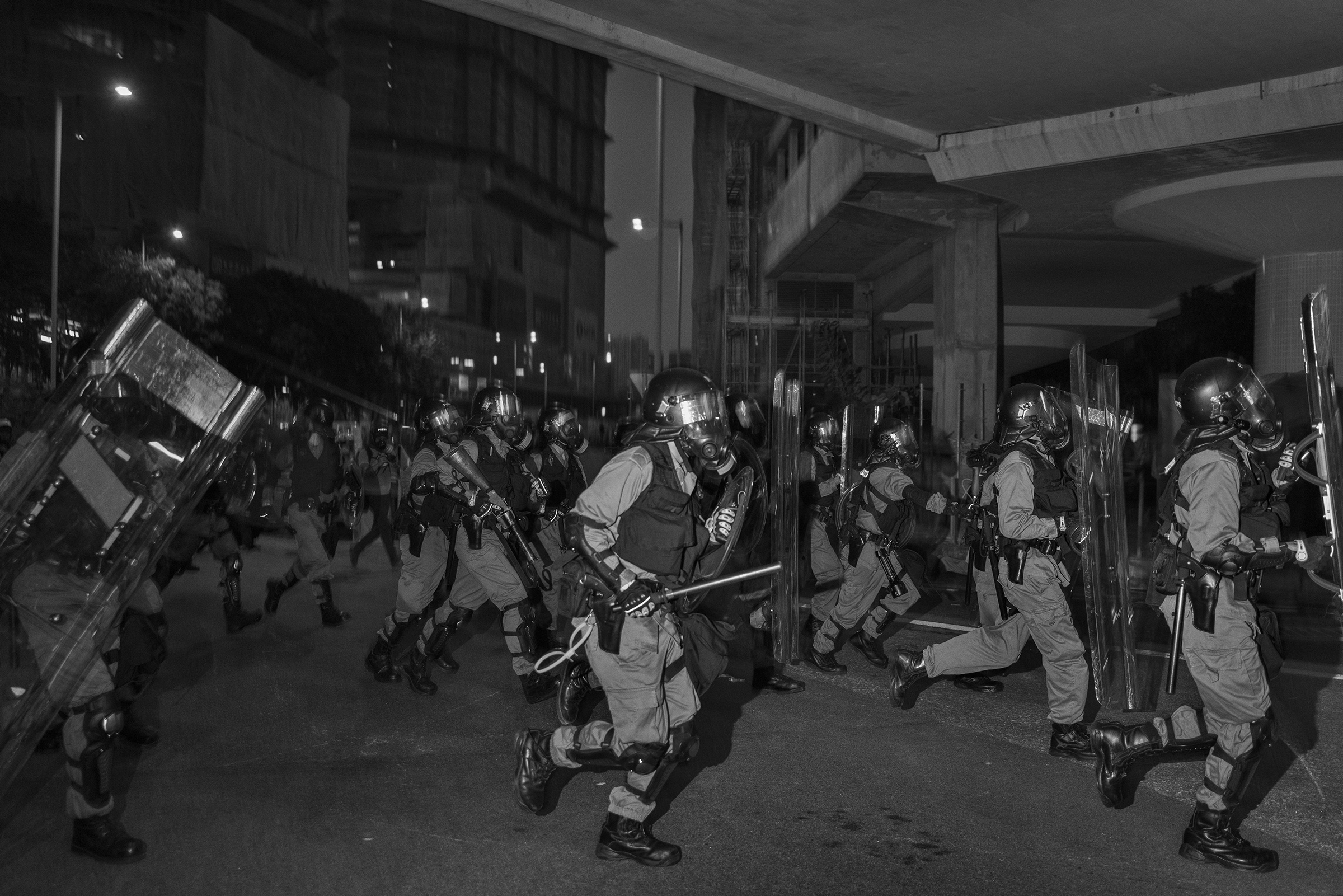 Riot police clear an unauthorized antigovernment protest near the Tai Wai train station on Aug. 10.