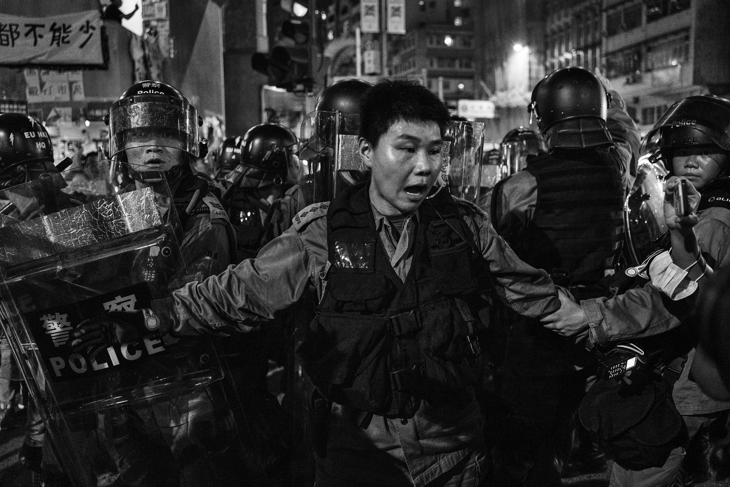 Police and local residents clash in the Sai Wan Ho area of Hong Kong on Aug. 12.