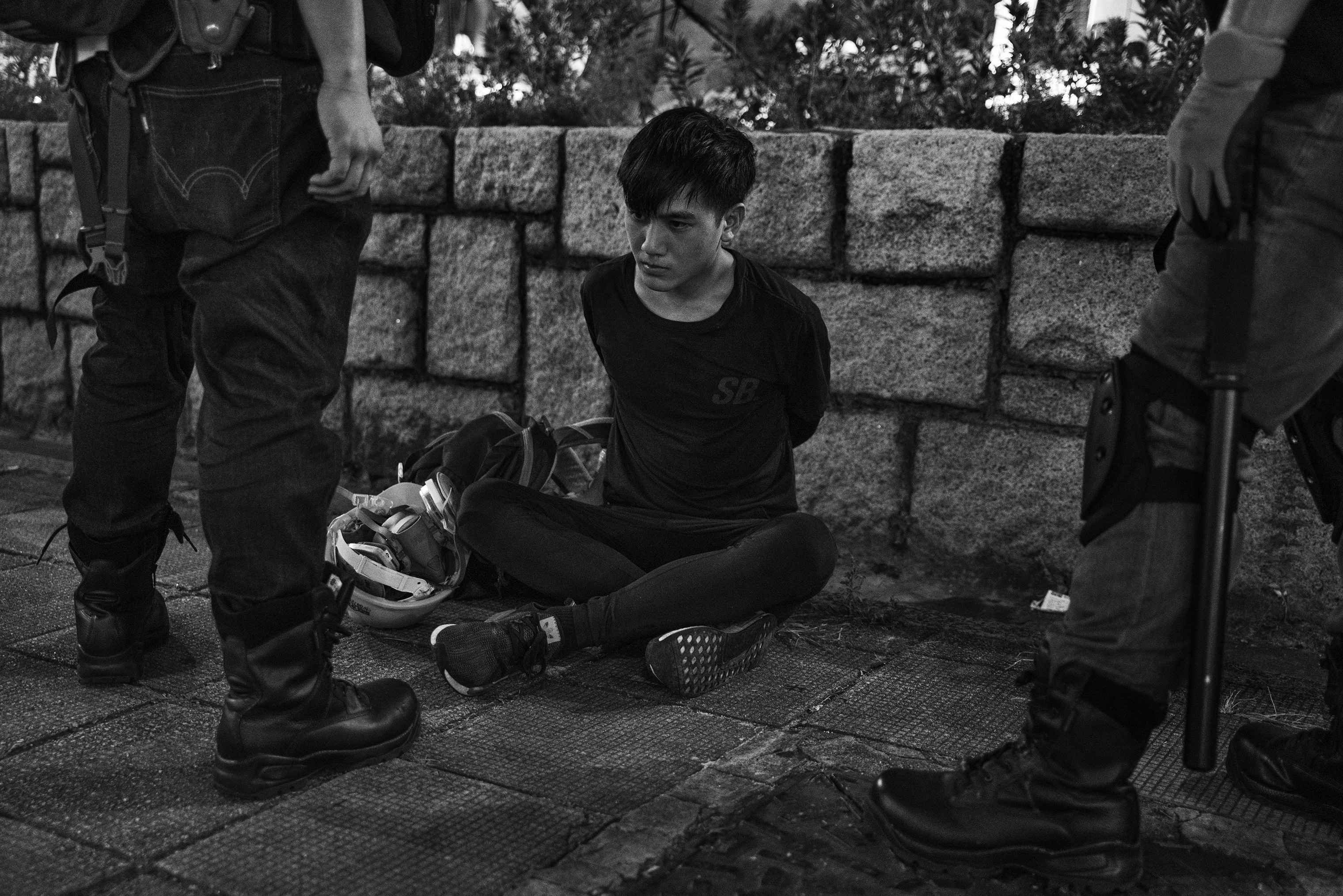 An antigovernment protester is arrested near the Tsim Sha Tsui police station in Kowloon, Hong Kong, on Aug. 11.
