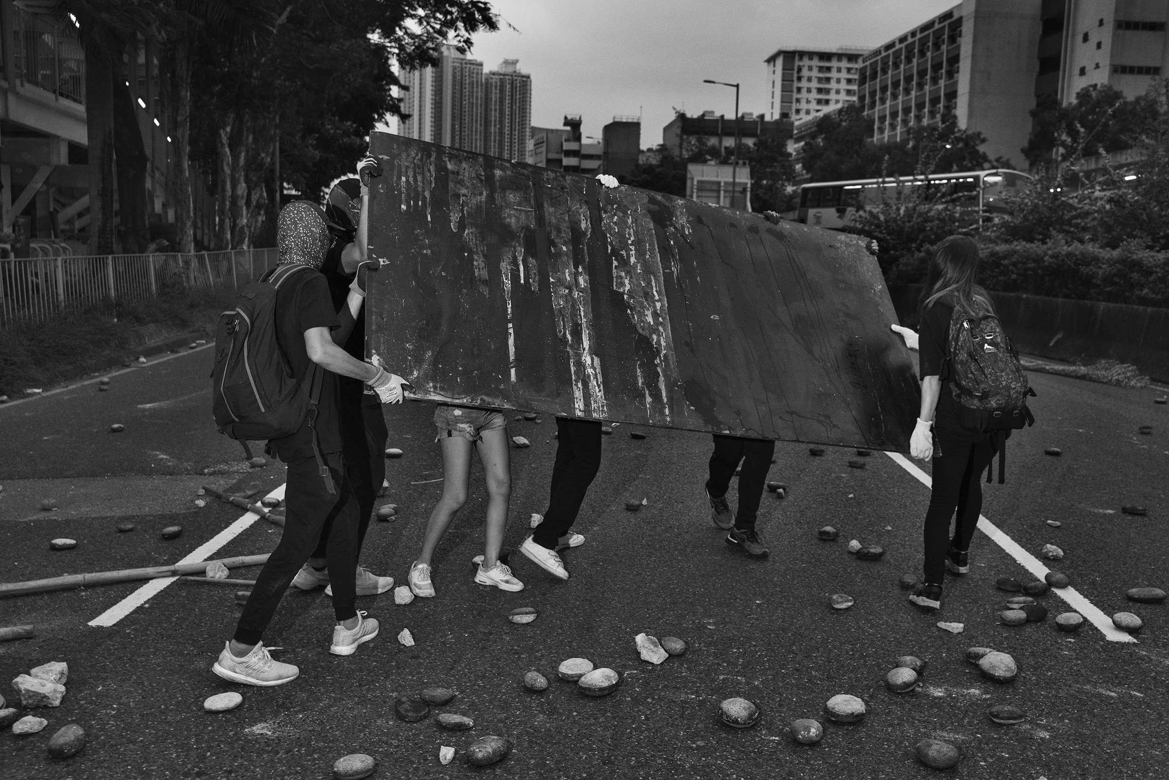 Antigovernment protesters block a road near the Tai Wai train station on Aug. 10.