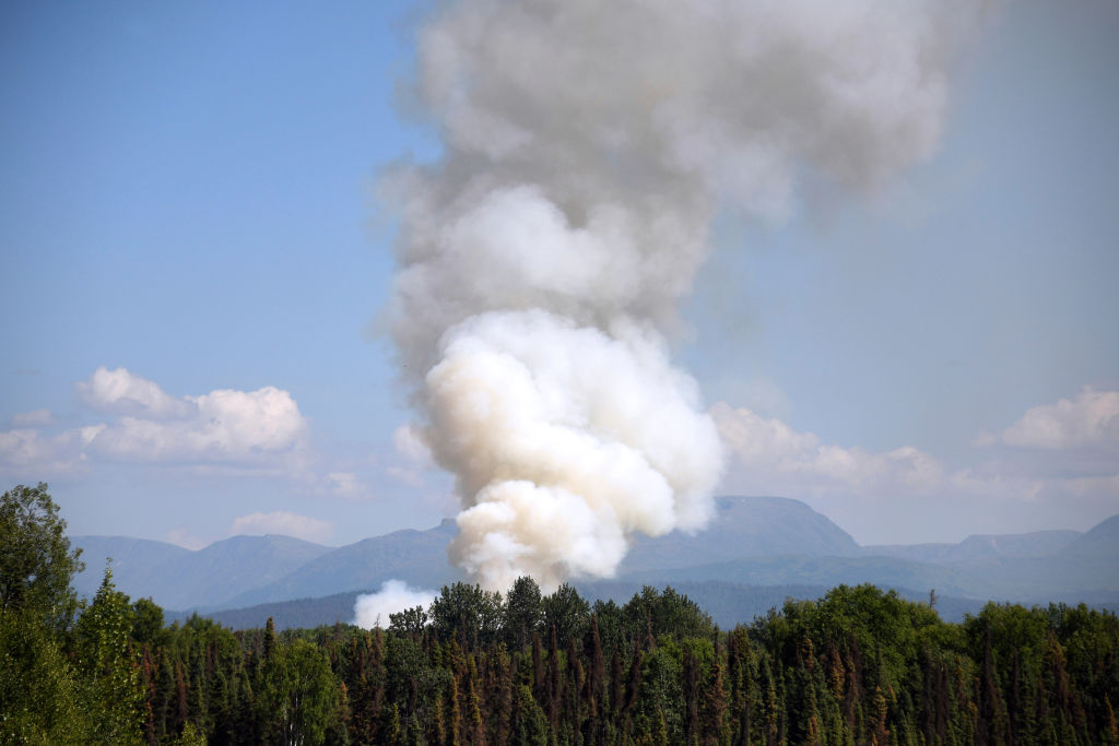 Smoke rises from a wildfire on July 3, 2019 south of Talkeetna, Alaska near the George Parks Highway. Alaska is bracing for a dangerous fire season with record warm temperatures and dry conditions in parts of the state.