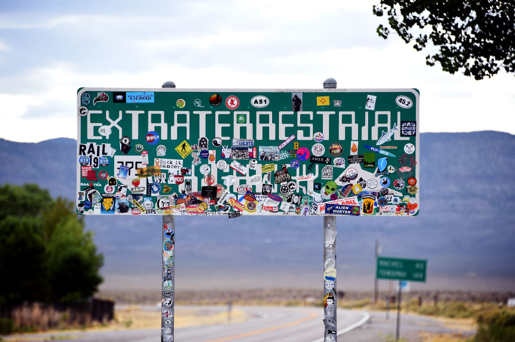 An Extraterrestrial Highway sign covered with stickers is seen along state route 375 on July 22, 2019 near Rachel, Nevada. State officials drew inspiration from the alien legends at the nearby top-secret military installation known as Area 51 and dubbed the 98 mile route from U.S. highway 93 to U.S. highway 6, the Extraterrestrial Highway in February 1996.