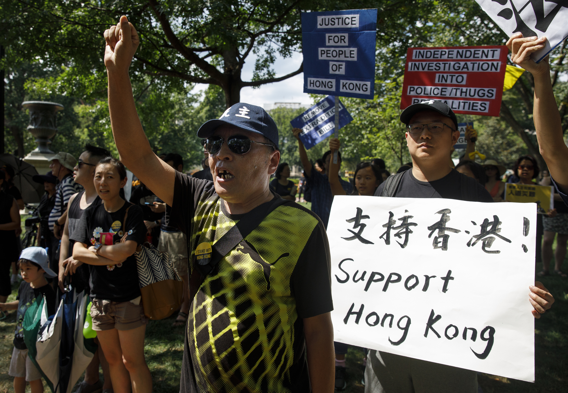 People gather in Lafayette Square in front of the White House in Washington, Sunday, Aug. 18, 2019, in solidarity with the  Stand With Hong Kong, Power to the People Rally  in Hong Kong.