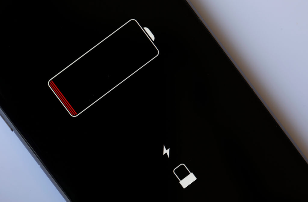 In this photo illustration, an Apple mobile phone iPhone 6 on the screen of which we can see the battery charge indicator is displayed on February 1, 2018 in Paris, France.